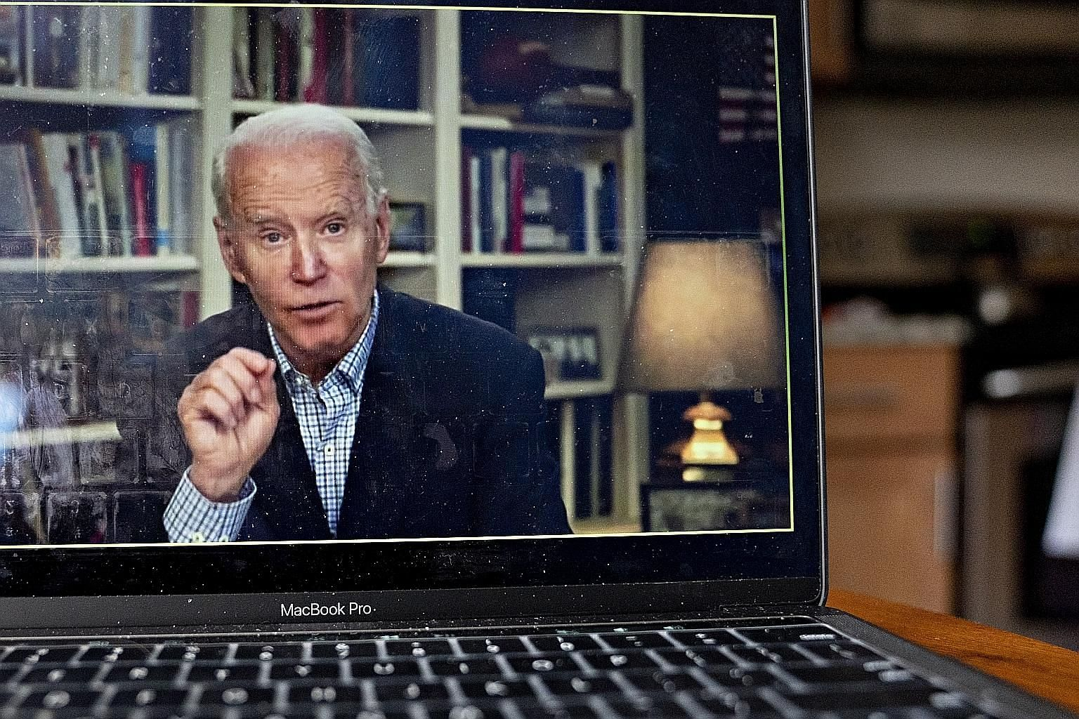 Democratic presidential candidate Joe Biden speaking during a virtual press briefing last Wednesday. Desperate to stay relevant, Mr Biden and his rival Bernie Sanders are participating in multiple webcasts, including roundtables with their respective