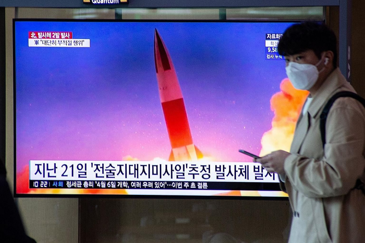 A news broadcast on North Korea's latest projectile launch seen at a Seoul train station yesterday. North Korea fired what appeared to be two short-range ballistic missiles from the coastal Wonsan area, according to South Korea, which called for an i