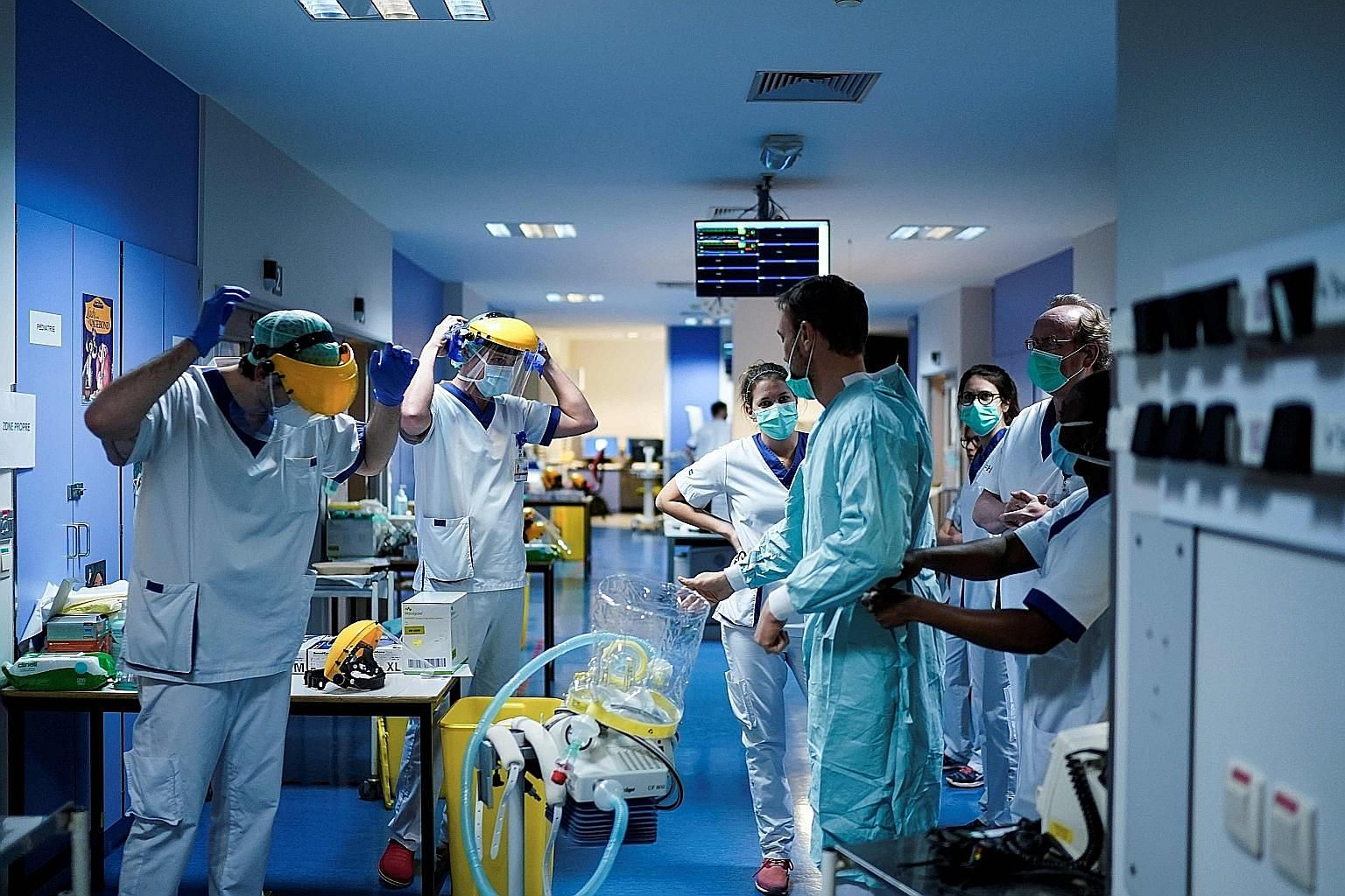 Medical staff putting on protective gear last Friday before treating Covid-19 patients at the Erasme Hospital in Brussels. The adoption of a road map for the global community is vital because there will be another outbreak in the future, perhaps more