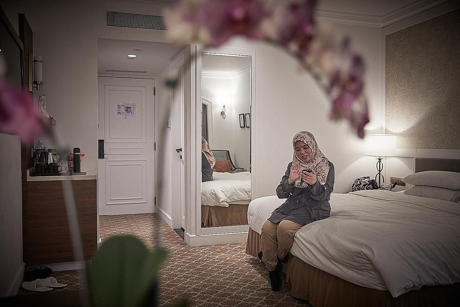"""""""When I handed my passport to (the) immigration officer, my hand was shaking,"""" recalled Madam Nelly Hamdin, 45, as she recounted the day - March 17, a day before the lockdown - when she left her family behind in Malaysia. """"My youngest son held onto m"""