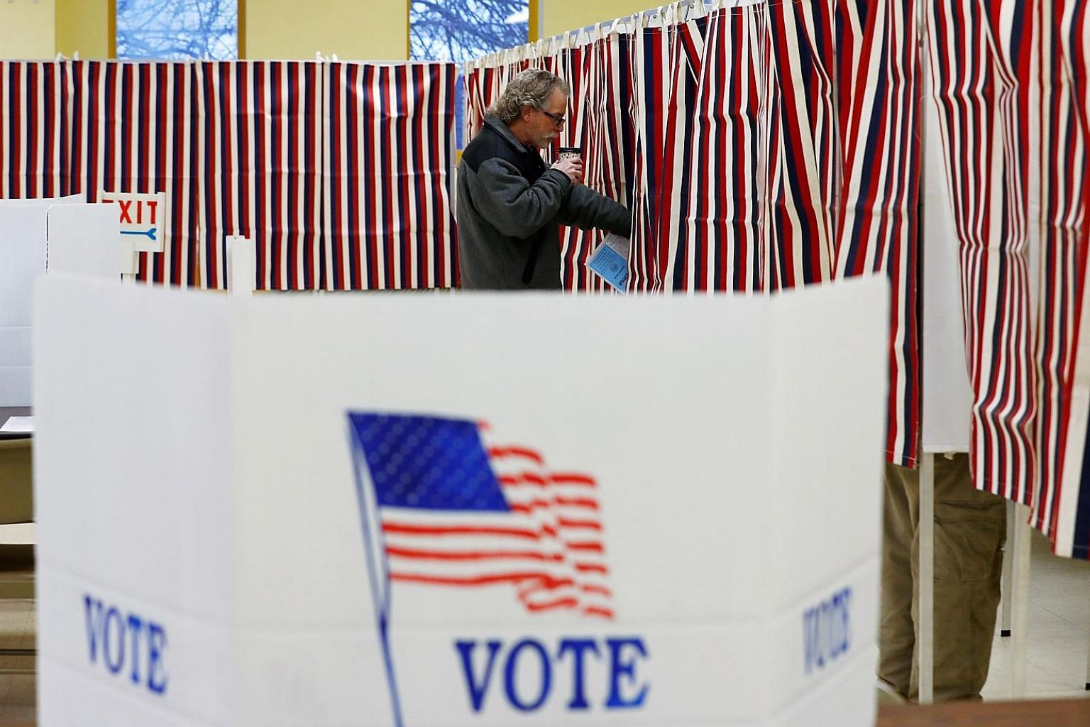 A voting station for the New Hampshire primary last month. Facebook and other big tech firms have been working to avoid a repeat of the 2016 election, when their platforms were overrun by Russian trolls. But US partisan groups have now borrowed Russi