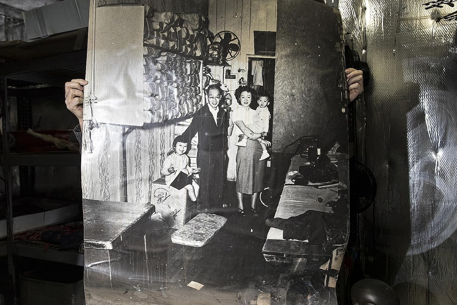 This poster-size photo of the Chin family in Sam Wah Laundry in the Bronx in 1952 was rescued after a fire broke out at the Museum of Chinese in America.