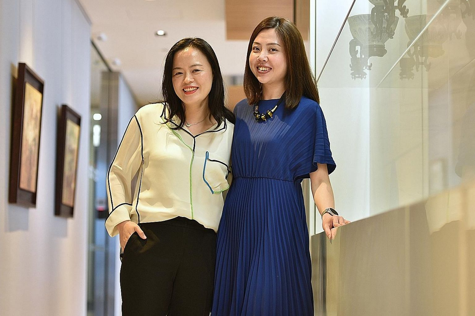 Ms Kay Choi (far left), who is from South Korea, and her Singaporean colleague, Ms April Ho, in the Citi Singapore office. The two women have struck up a friendship outside of work.