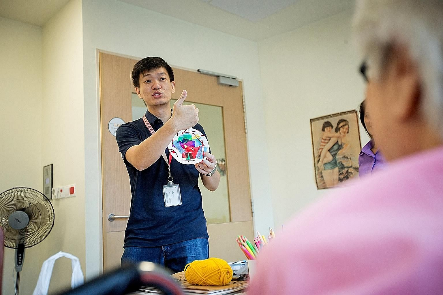 Art therapist Lee Sze-Chin during a session at Jurong Community Hospital. Instead of holding sessions on different premises, he now conducts his art therapy sessions at just one organisation - St Luke's Hospital - and does some of these sessions thro