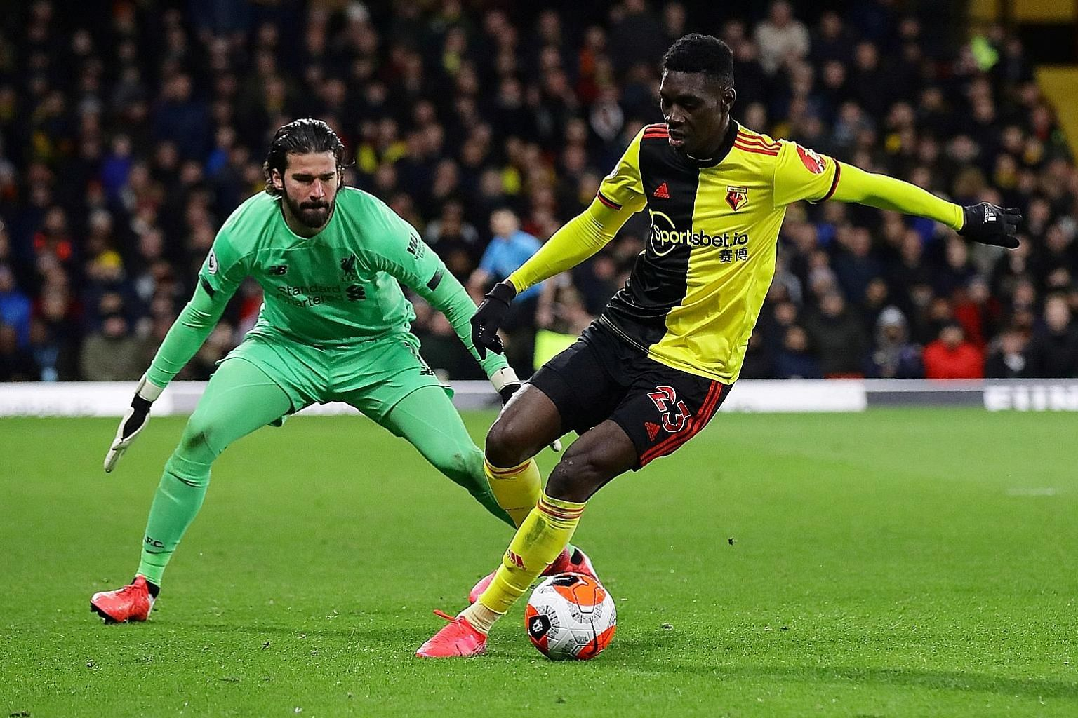 Watford's Ismaila Sarr, coming up against Liverpool goalkeeper Alisson Becker, scored two goals in the stunning 3-0 win over the Premier League runaway leaders at Vicarage Road on March 1. PHOTO: REUTERS