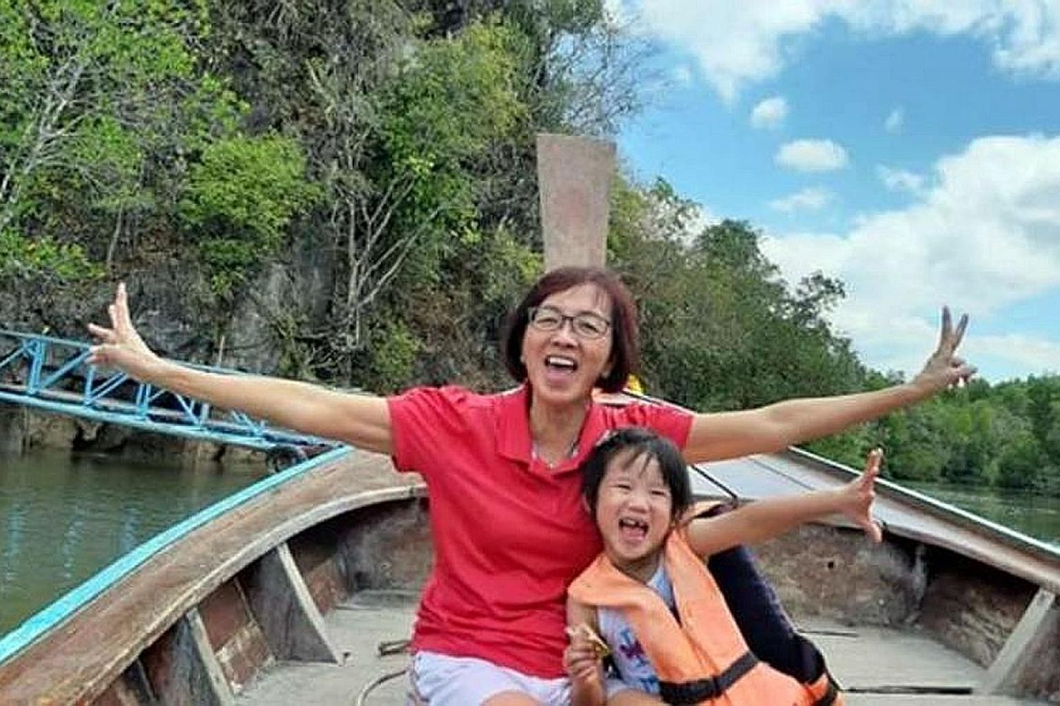 A 69-year-old woman and her five-year-old granddaughter were critically injured in an accident involving the van they were in and a car on March 22. The woman died in hospital on Sunday, five days after her granddaughter's funeral. PHOTO: DERRICK NG/