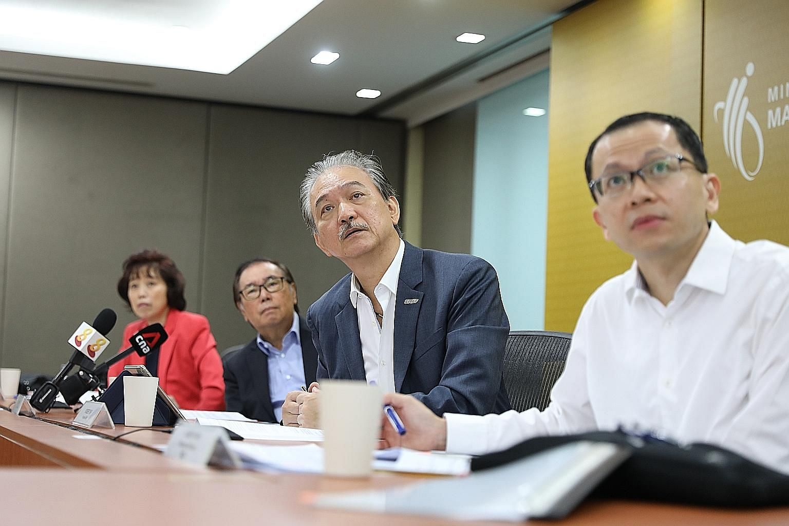 From left: National Trades Union Congress president Mary Liew, National Wages Council chairman Peter Seah, Singapore National Employers Federation president Robert Yap and Permanent Secretary for Manpower Aubeck Kam at yesterday's media conference. S