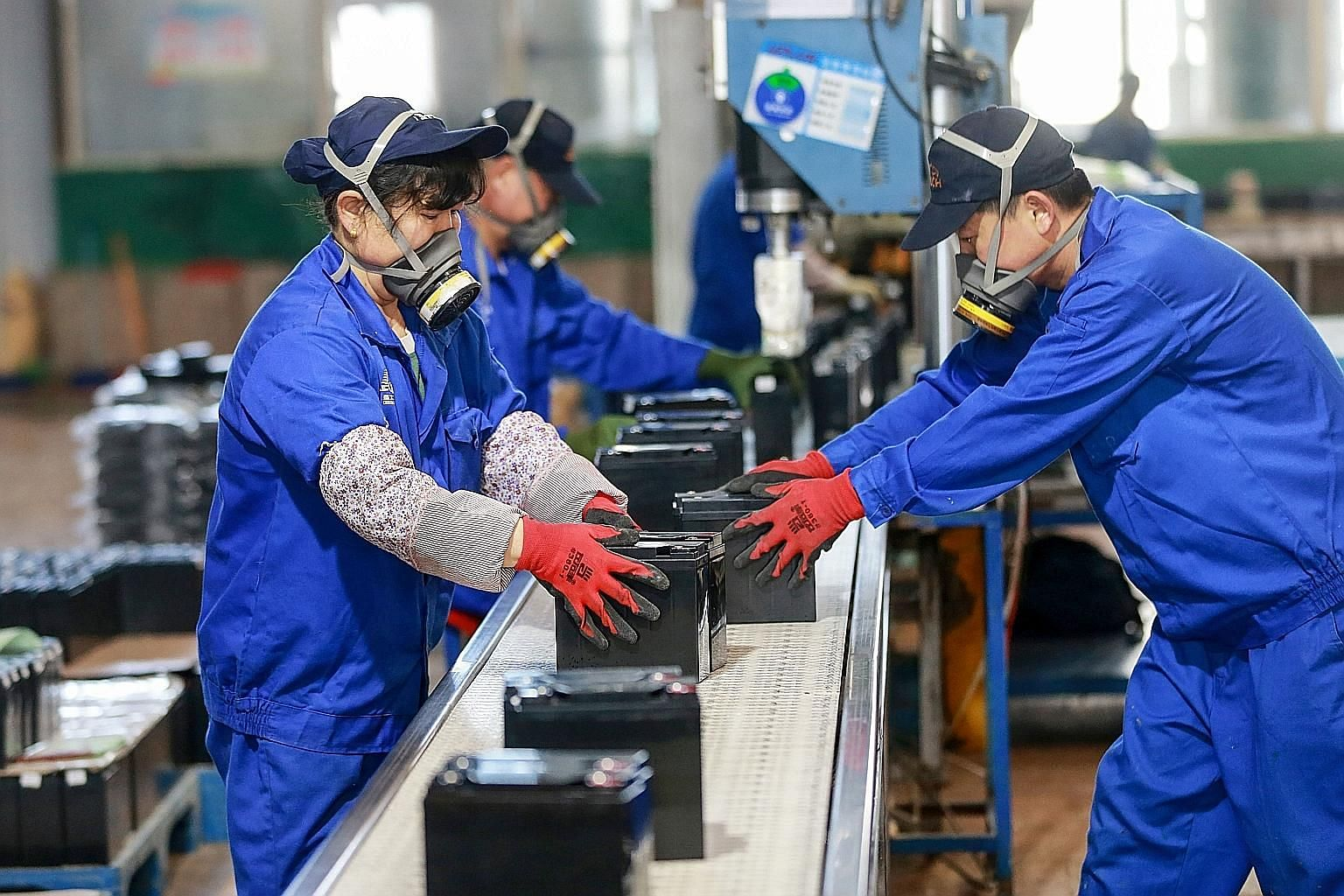 Employees working on a battery production line at a factory in eastern Anhui province on Monday. Factory activity in China rebounded last month from a record low in February, but analysts warn of a further period of struggle due to the rapid spread o