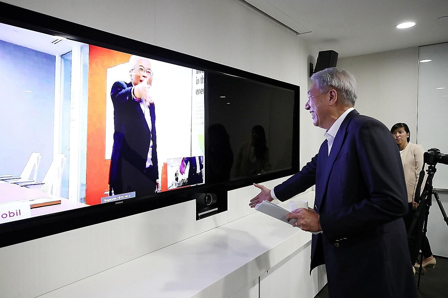 Senior Minister Teo Chee Hean participating in a virtual conference yesterday with Mr Gan Seow Kee, chairman and managing director of ExxonMobil Asia Pacific.