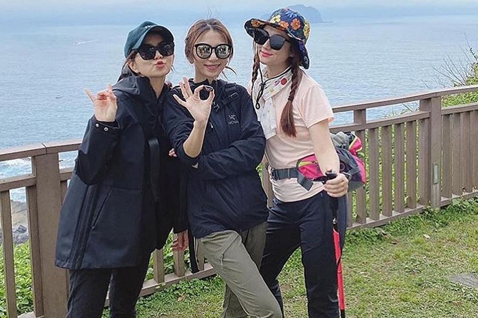 S.H.E members (from left) Ella Chen, Hebe Tien and Selina Jen went hiking in Wangyou Valley in Taiwan's Keelung city.