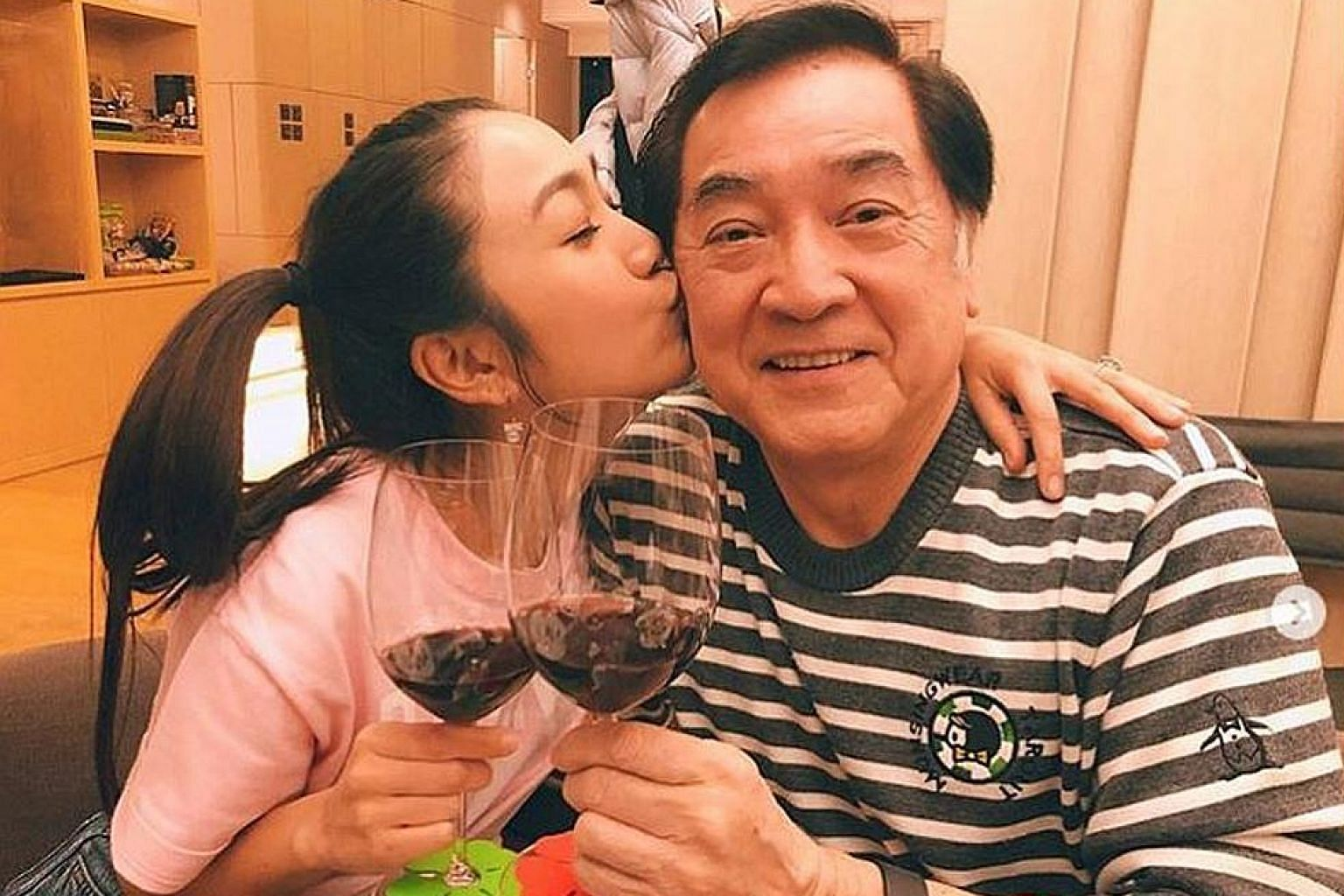 Singer Lesley Chiang with her father Chun Pui (both left).