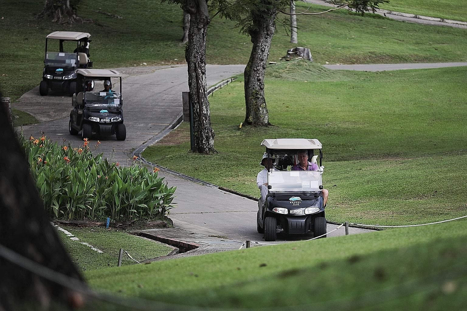 Clockwise from above: Golfers travelling in their buggies at the Keppel Club golf course while golf executive Muhammad Izan, 39, is taking the temperature of golfer Tan Hua Joo, 49. Buggies at Orchid Country Club has a plastic divider between the sea