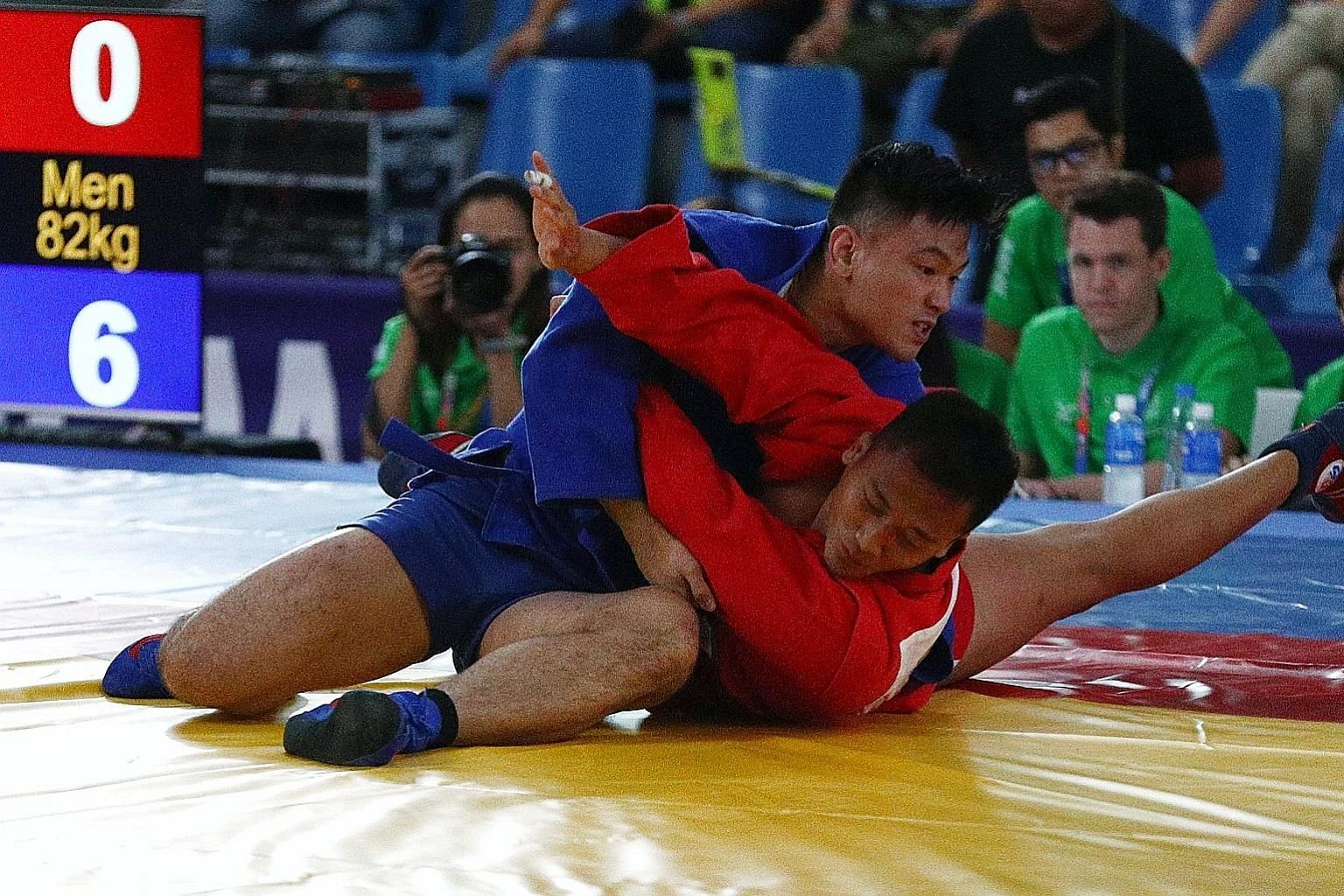 Gary Chow competing at last year's SEA Games in the sambo 82kg event. The Singaporean, who won silver in the Philippines, had pulled out of the judo squad for the Games. LIANHE ZAOBAO FILE PHOTO