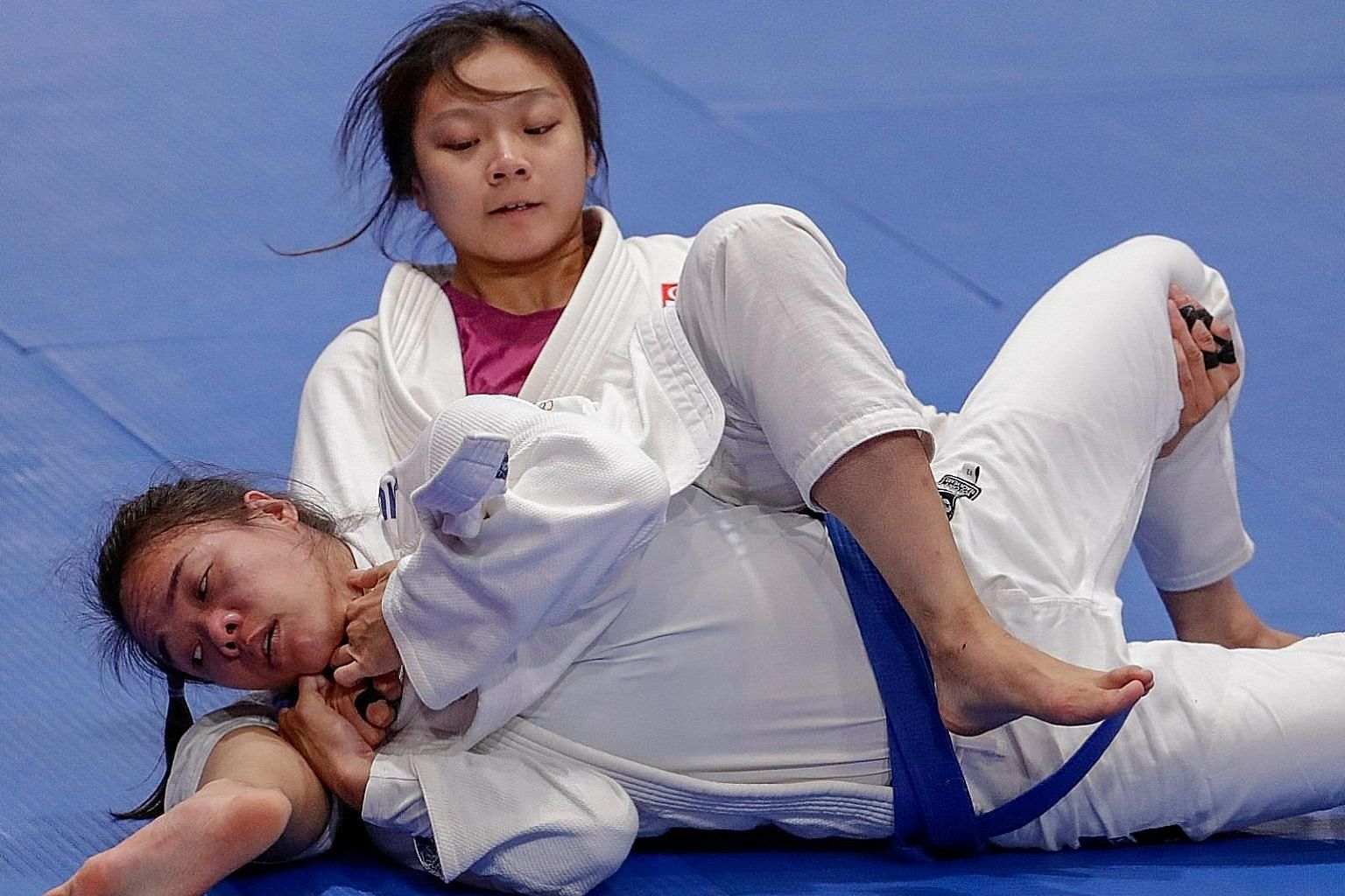 Constance Lien proving too strong for Vietnam's Nguyen Ngoc Tu in the ne-waza Under-62kg final last year, clinching her first SEA Games gold medal. The Singaporean is one of 17 first-time recipients of the spexScholarship. PHOTO: SPORT SINGAPORE