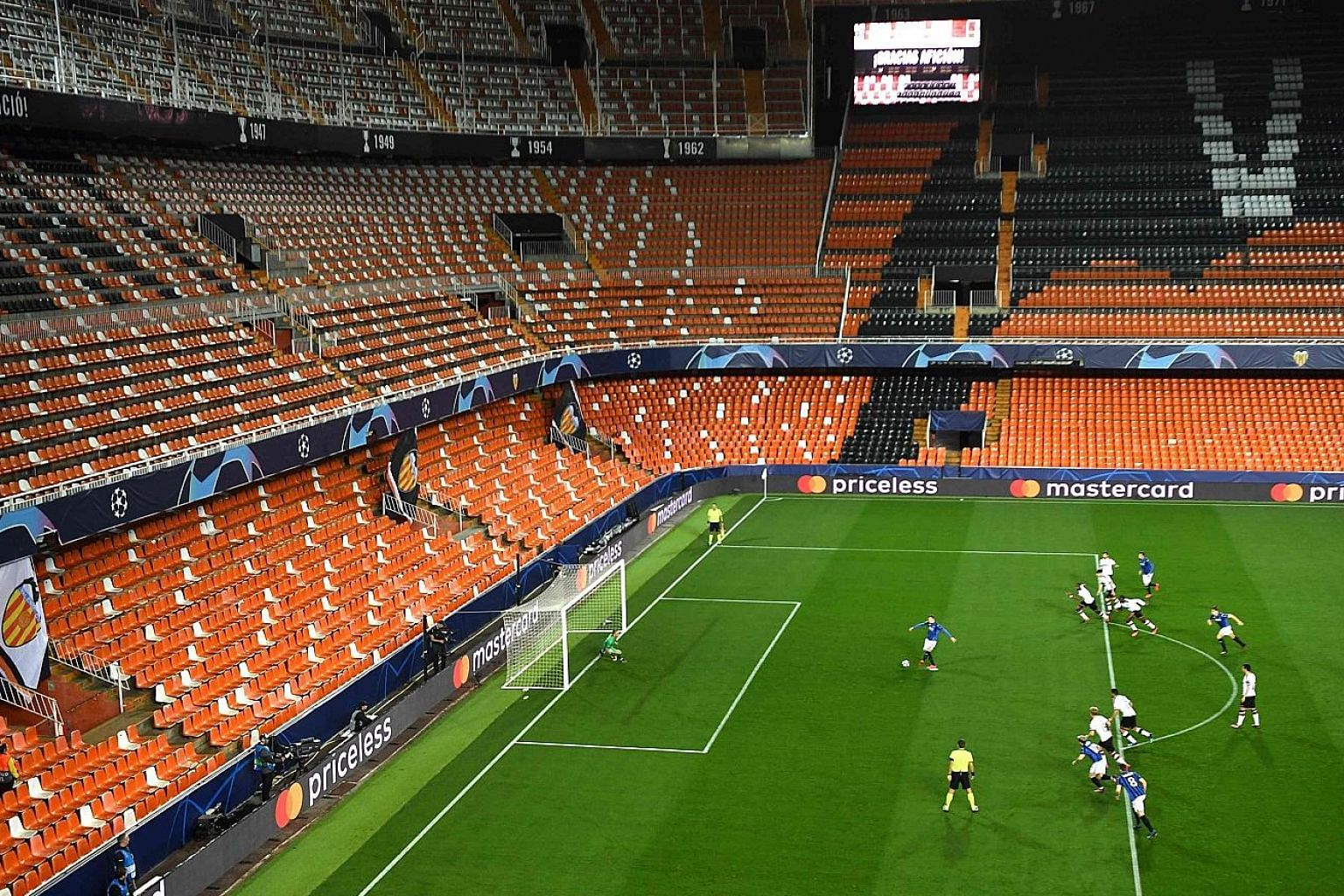 Atalanta's Josip Ilicic scoring one of his four goals against Valencia in a 4-3 win at the Spanish team's Mestalla stadium during a closed-door Champions League match on March 10. Only four of the eight round-of-16 ties were completed before Europe's