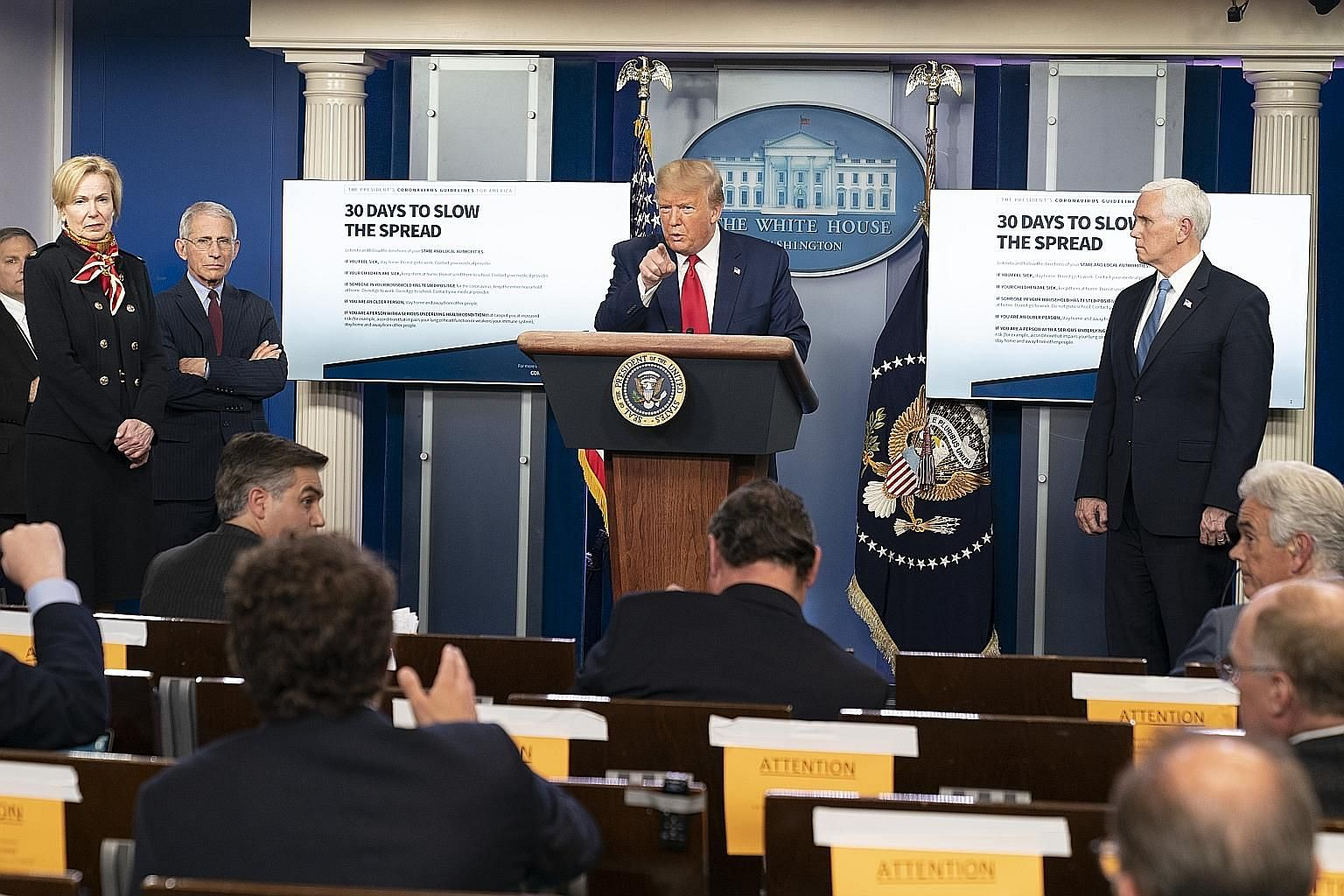 US President Donald Trump at a coronavirus task force news conference at the White House in Washington on Tuesday. Mr Trump's approval ratings are as high as they have ever been, despite what most agree to be his slow performance dealing with the cri