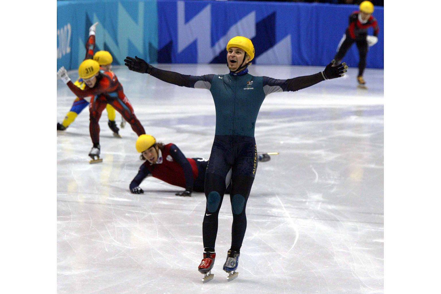 Steven Bradbury of Australia lifting his arms aloft after winning Olympic gold in the 1,000m short track speed skating final in 2002. He skated past the US' Apolo Ohno, Canada's Mathieu Turcotte, South Korean Ahn Hyun-soo and China's Li Jiajun, all o
