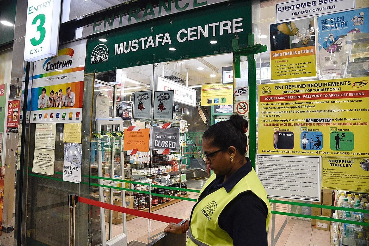 A sign put up late last night at the 24-hour Mustafa Centre, announcing that it would be closed until further notice. A total of 11 cases - including those announced earlier - have been linked to the cluster.