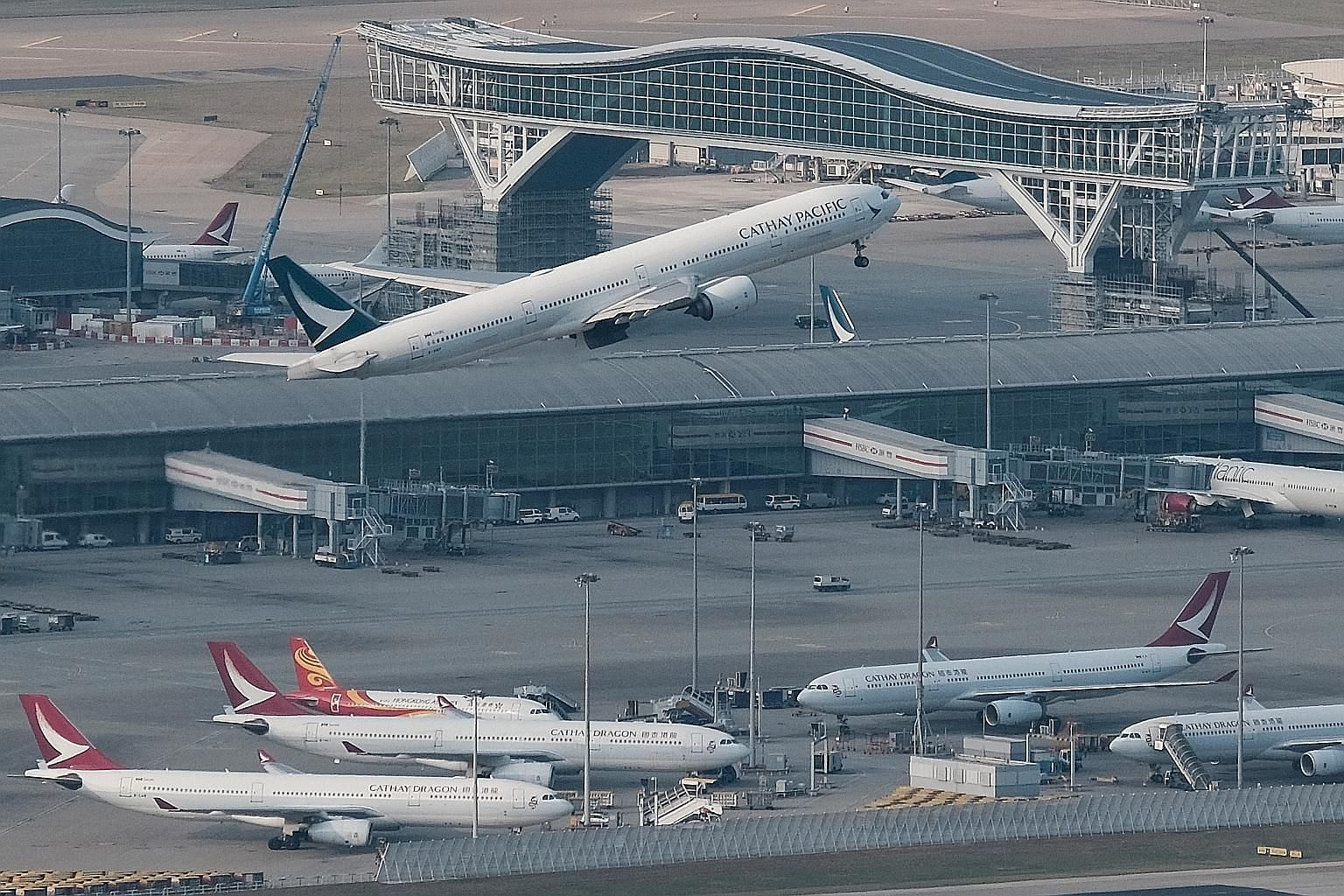 Cathay Pacific will maintain a skeleton long-haul network with two weekly passenger flights from Hong Kong to London, Los Angeles, Vancouver and Sydney, according to the carrier's internal memo. PHOTO: REUTERS