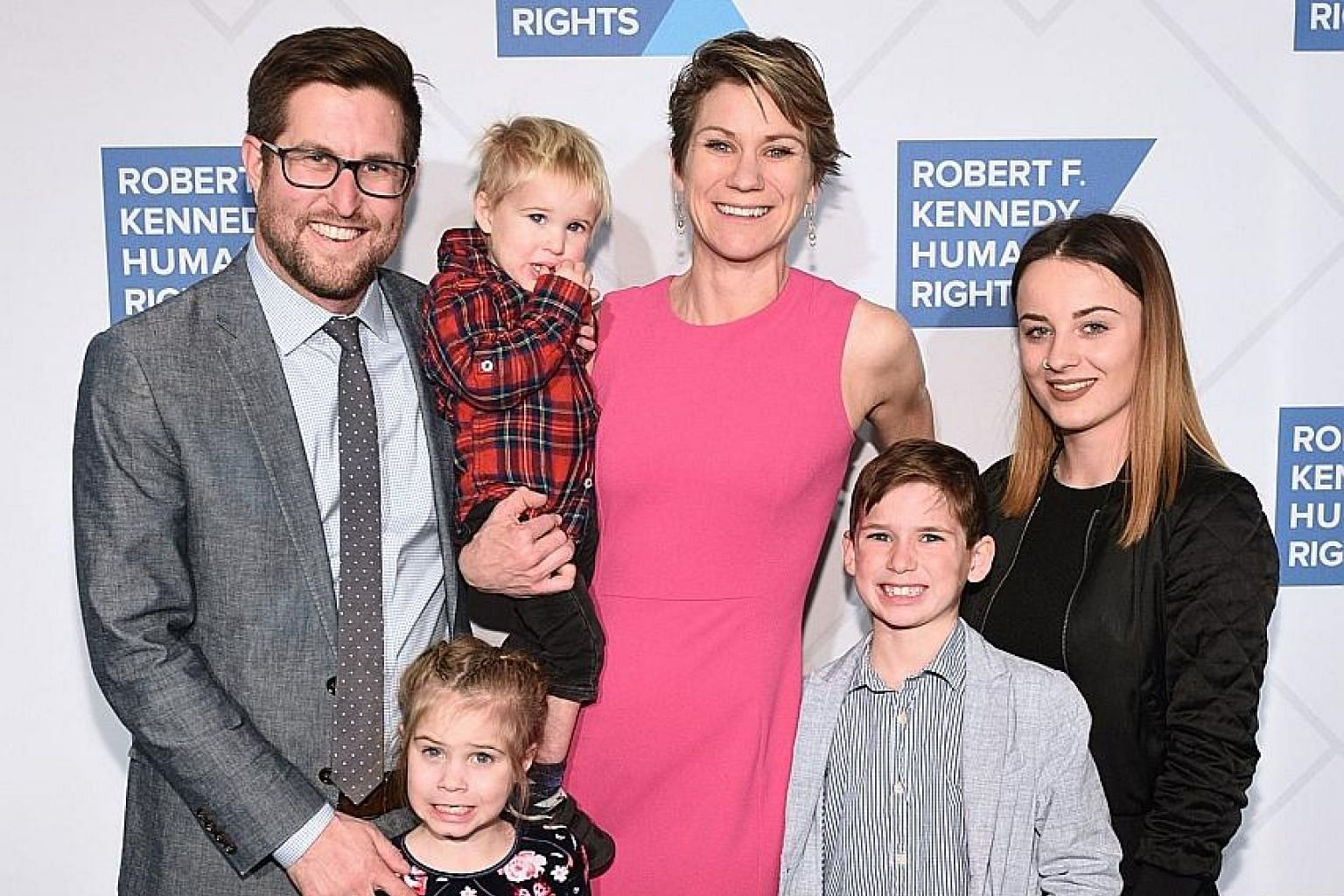 Mrs Maeve Kennedy Townsend McKean, 40, and eight-year-old son Gideon with family at an event in New York City last December. The mother and son, last seen on Thursday, had paddled out in a canoe to retrieve a ball that went into the Chesapeake Bay in