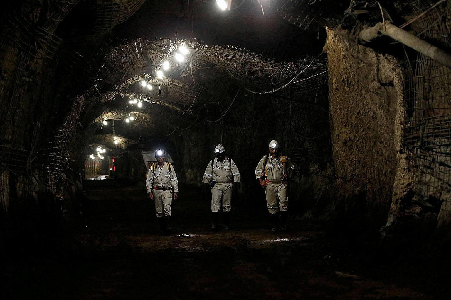 A 2017 file photo of gold-mine workers in South Africa. Worldwide panic over the coronavirus outbreak and a flood of stimulus by central banks have ignited demand for one of humanity's oldest methods of storing wealth.