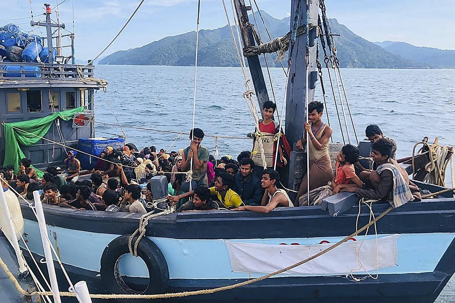 A photo from the Malaysian Maritime Enforcement Agency showing a wooden boat carrying suspected Rohingya migrants who had been detained in Malaysian territorial waters, off the island of Langkawi, yesterday. A boatload of more than 200 Rohingya refug