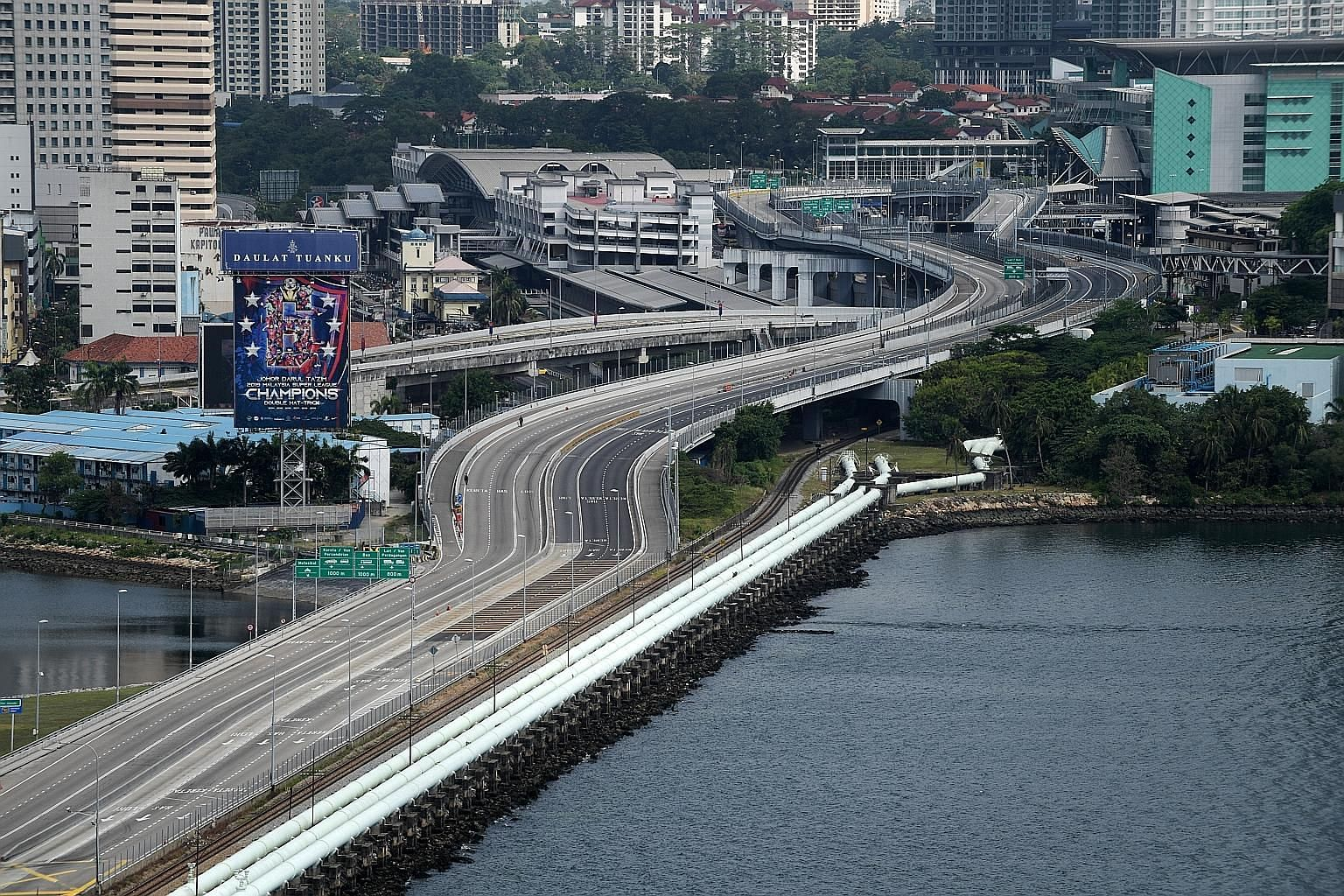 A traffic-free Causeway after Malaysia imposed its movement control order on March 18. The Malaysiakini news portal said Malaysians who are returning home should undergo a swab test in Singapore and present the certificate at the entry points.