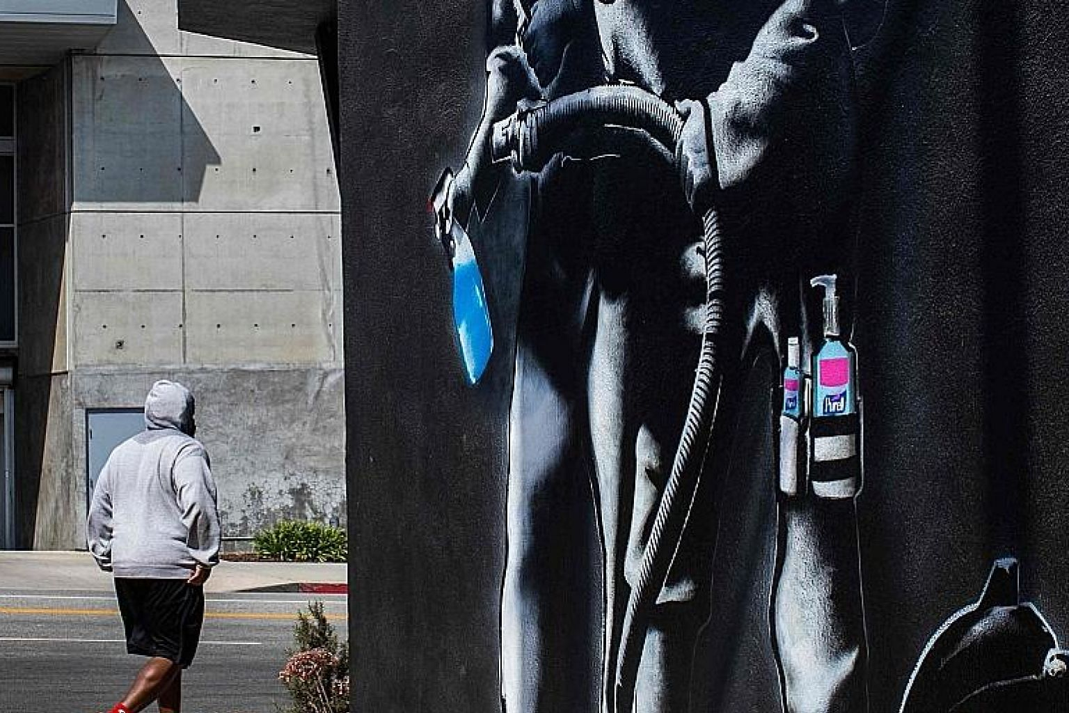 An apocalyptic mural in Los Angeles, California, by Hijackhart, where soldiers wearing face masks fight the Covid-19 disease with disinfectant and hand sanitiser amid the coronavirus pandemic. Delayed responses by China and the US (and Europe) have i