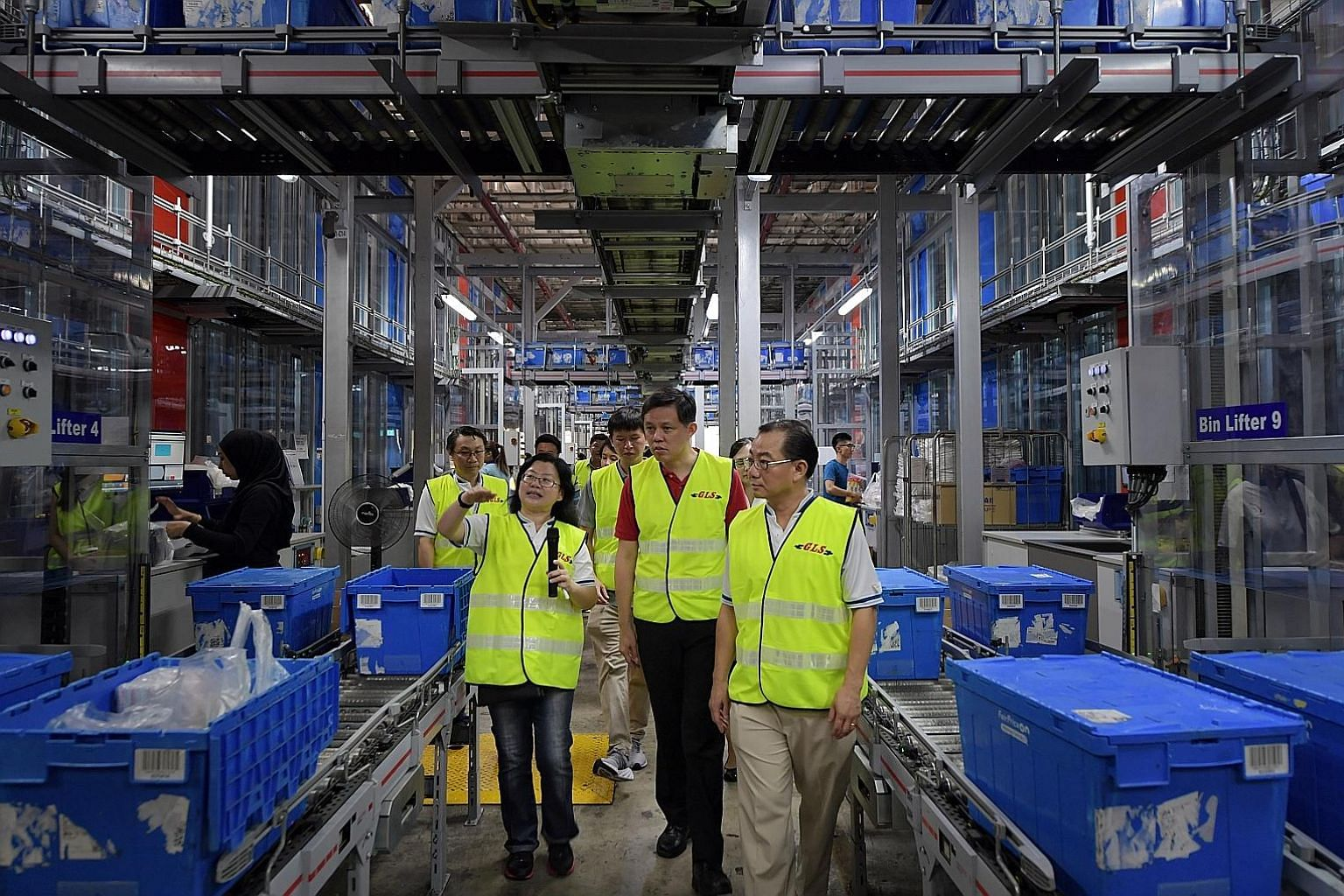 Trade and Industry Minister Chan Chun Sing (centre) taking a tour of FairPrice's Benoi Distribution Centre last month, accompanied by FairPrice chief executive Seah Kian Peng (right). Mr Seah yesterday said that prices will be kept affordable, despit