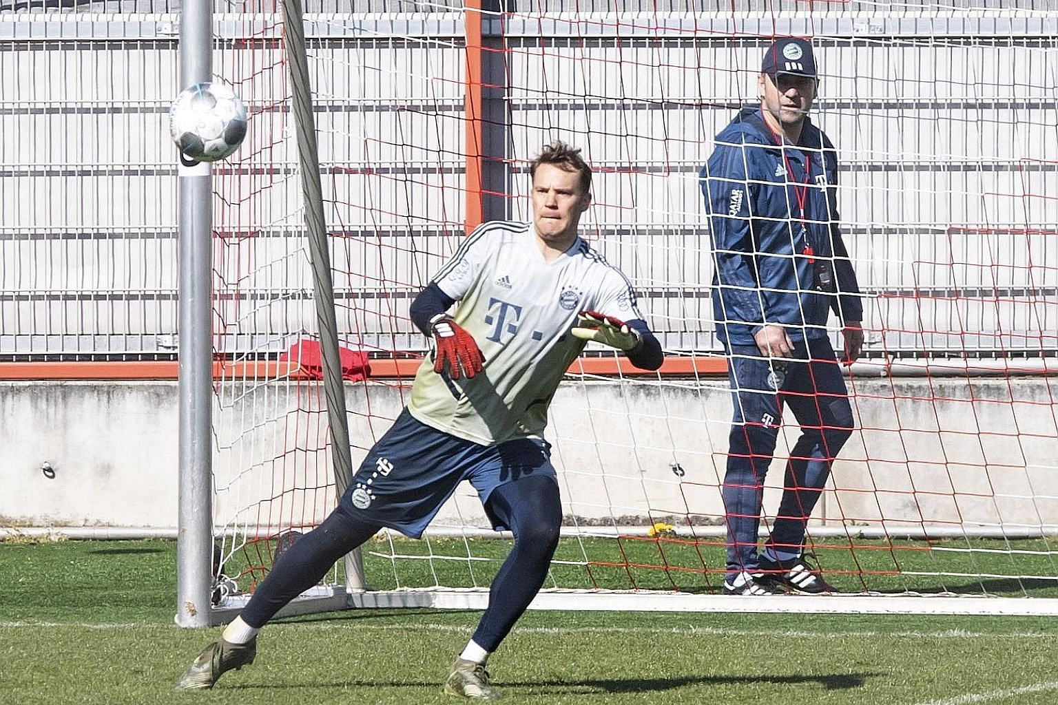 Bayern head coach Hansi Flick, who last week signed a contract extension to 2023, watching goalkeeper Manuel Neuer as the Bavarian side resumed training in groups of five and without contact in Munich yesterday. The Bundesliga remains suspended until