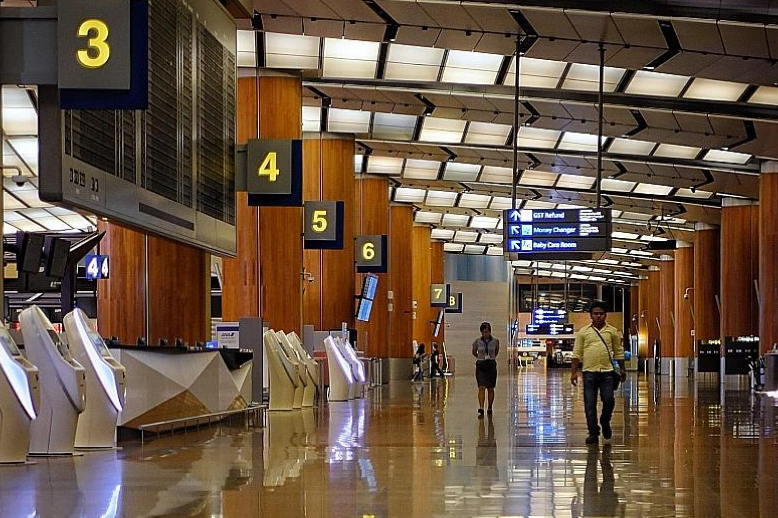 A near-empty Changi Airport T2 yesterday. Changi Airport Group said it decided to halt T2 operations in view of the steep fall in passenger traffic and the likelihood that air travel demand will not recover in the near term. ST PHOTO: MARK CHEONG