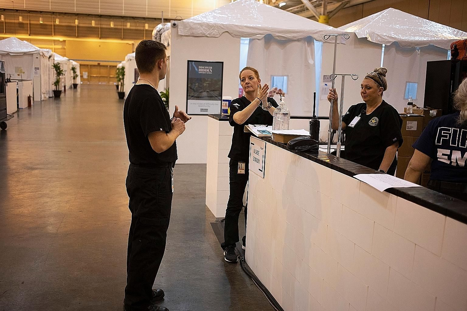 Nursing staff at the Ernest N. Morial Convention Centre in New Orleans preparing to take in coronavirus patients on Sunday. America has four times as many coronavirus cases and three times as many deaths, as of Monday, as have been reported in China,
