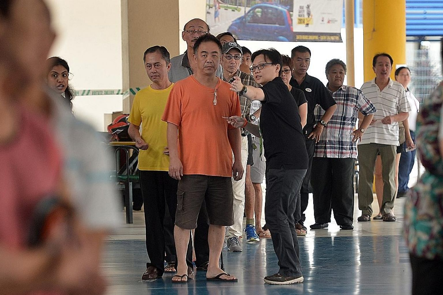 This 2015 photo shows people waiting to cast their ballots at Pei Chun Public School. Experts noted that passage of the Parliamentary Elections (Covid-19 Special Arrangements) Bill is a necessary step before the general election.