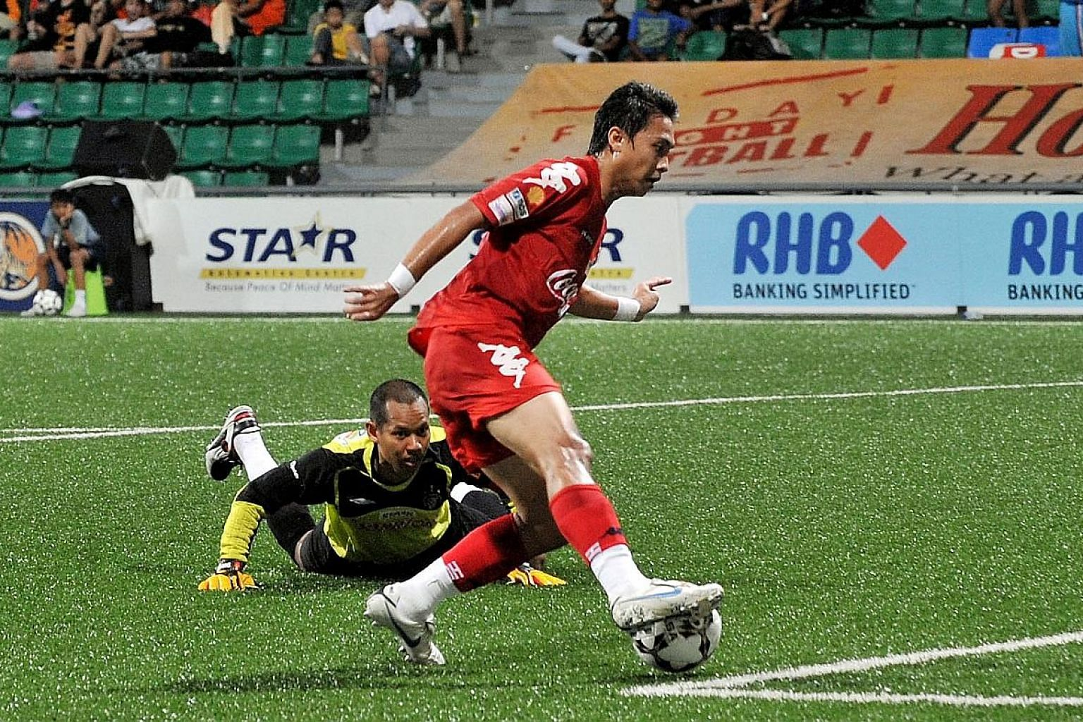 Top left: Shahril Ishak rounding SAFFC goalkeeper Shahril Jantan en route to netting the second goal of his hat-trick for Home United in their S-League match in 2010. Above: The iconic bicycle kick of V. Sundram Moorthy in 1993 which helped Singapore