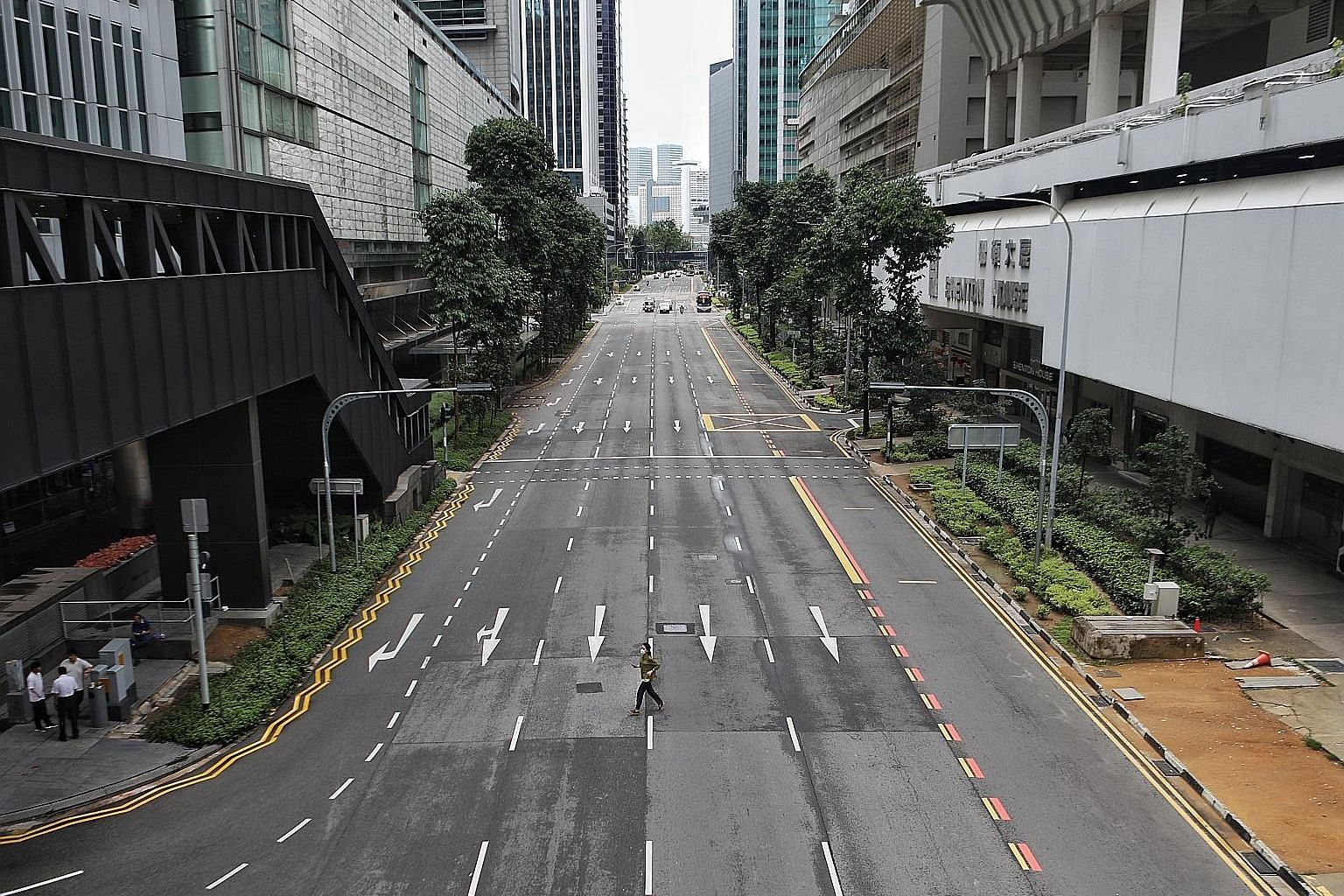 "A mostly deserted Shenton Way photographed at 10.15am yesterday, the first day of Singapore's ""circuit breaker"" month. ST PHOTO: JOEL CHAN"