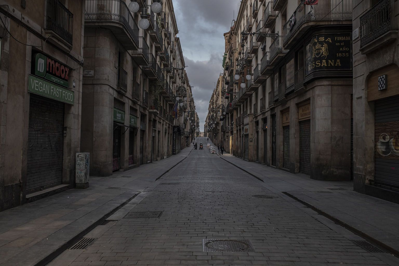 An empty street amid the coronavirus outbreak in Barcelona, Spain. Covid-19 has thrust into the limelight the responsibility that governments have for the livelihood and well-being of their citizens, says the writer. Besides business bailouts and sub