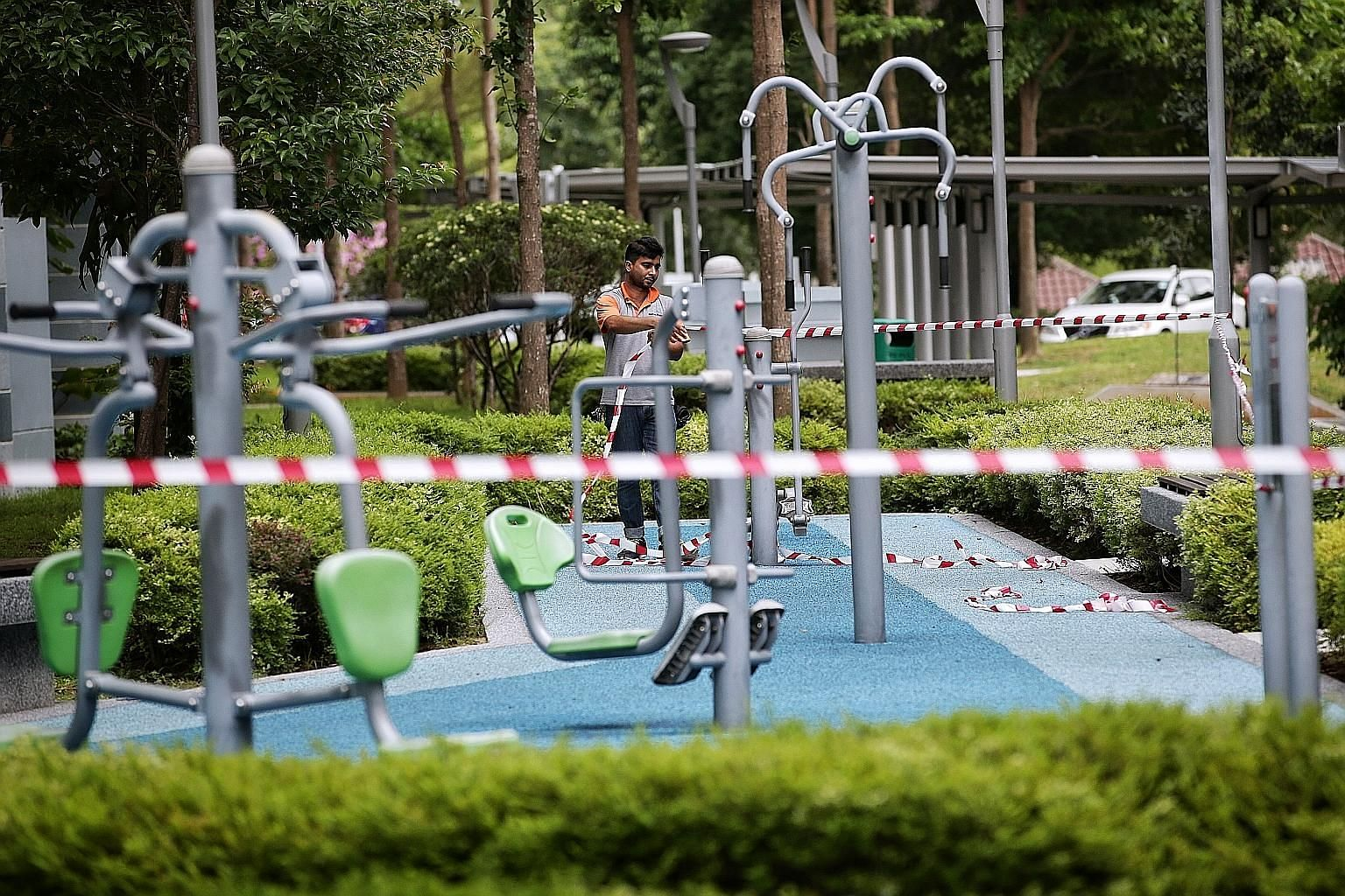 An exercise station in Pasir Ris being cordoned off as part of stricter social distancing measures. These measures would be deemed a resounding success if the number of daily cases falls to the single-digit zone by May 4, when the circuit-breaker pha