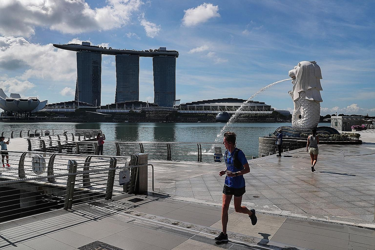 An almost empty Merlion Park yesterday. While necessary to contain the spread of the coronavirus, Singapore's circuit breaker measures through this month alone will impede economic growth in the second quarter and pull the economy into a deeper reces