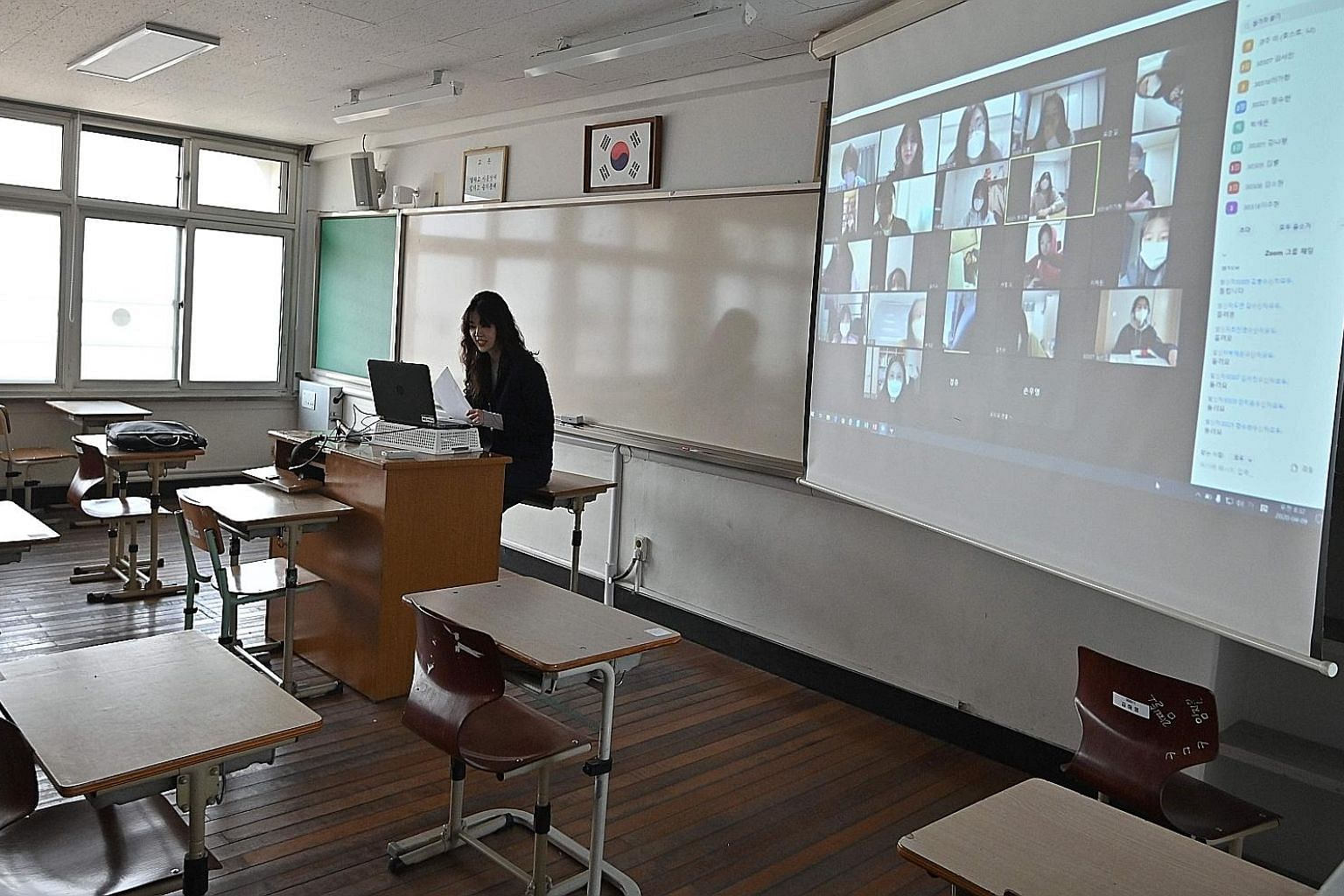 A teacher in Seoul conducting an online class for her students who are staying home amid measures to contain the coronavirus outbreak in South Korea. The country started the new school term yesterday with virtual classes for middle and high school se