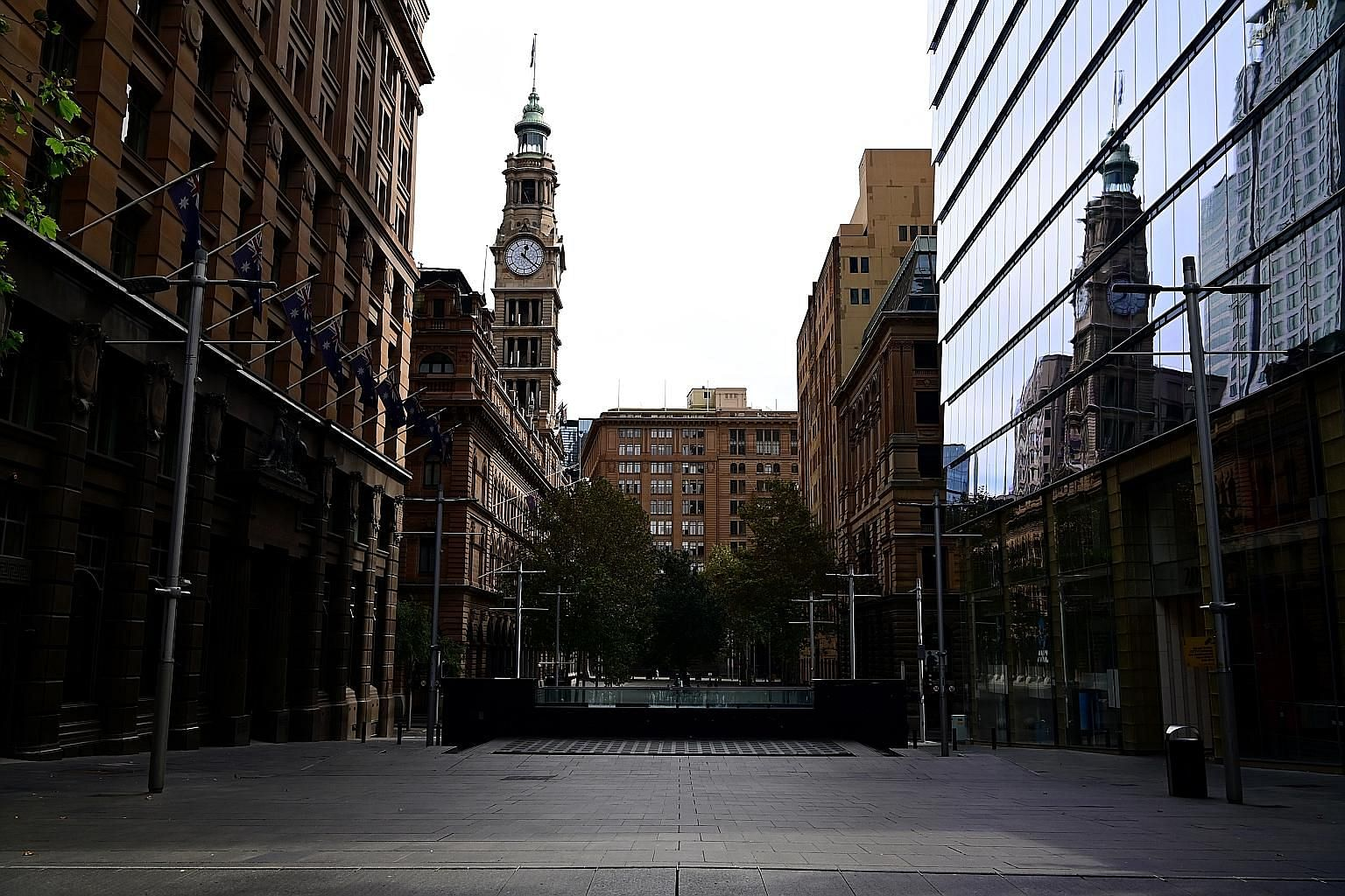An empty walkway through the normally bustling Martin Place in Sydney, Australia. The coronavirus outbreak has led to the country's political and ideological foes uniting in a concerted bid to save workers' jobs, among other things.