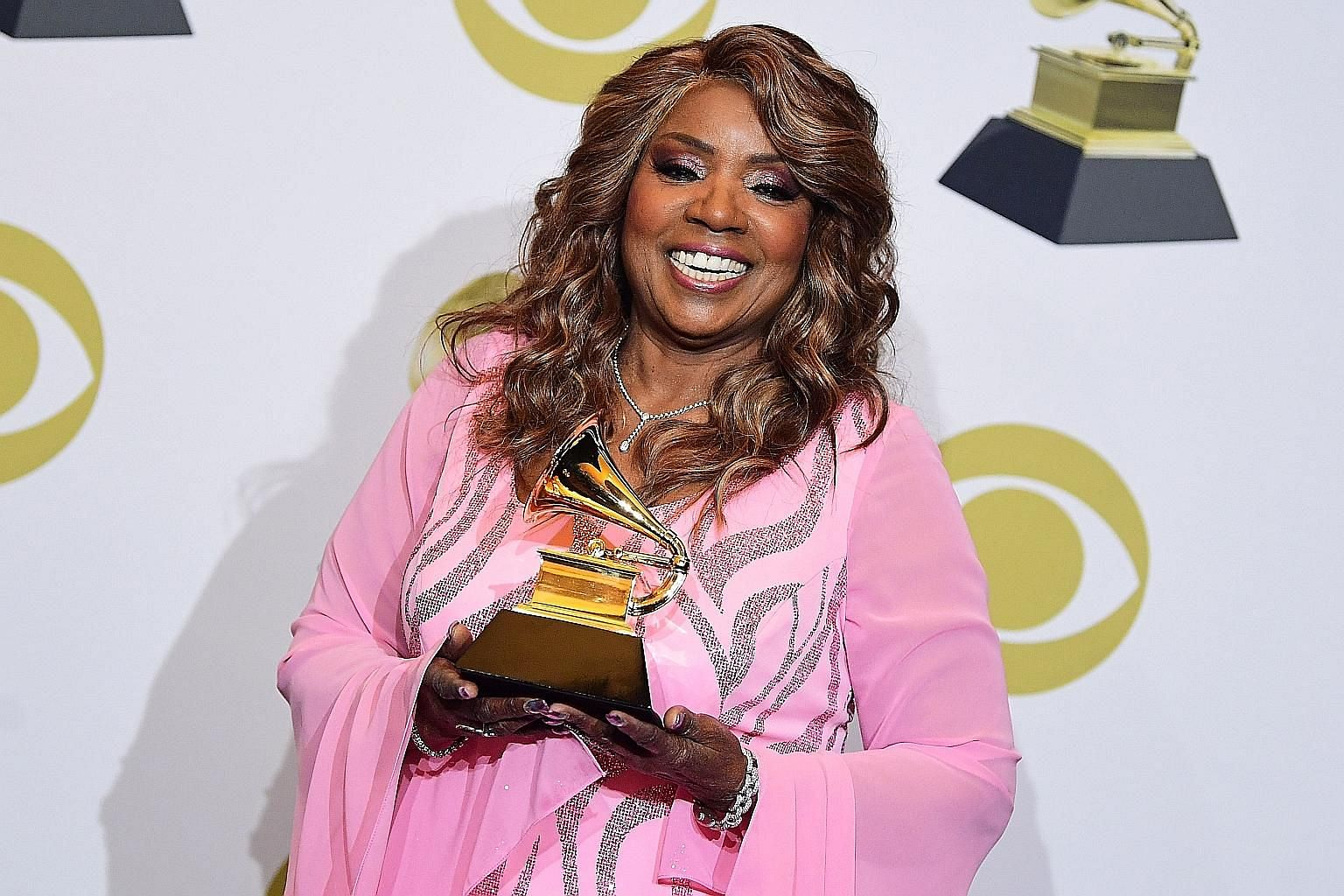 American singer Gloria Gaynor (left), with her award for Best Roots Gospel Album for Testimony during the Grammy Awards in January, was behind the hit, I Will Survive.