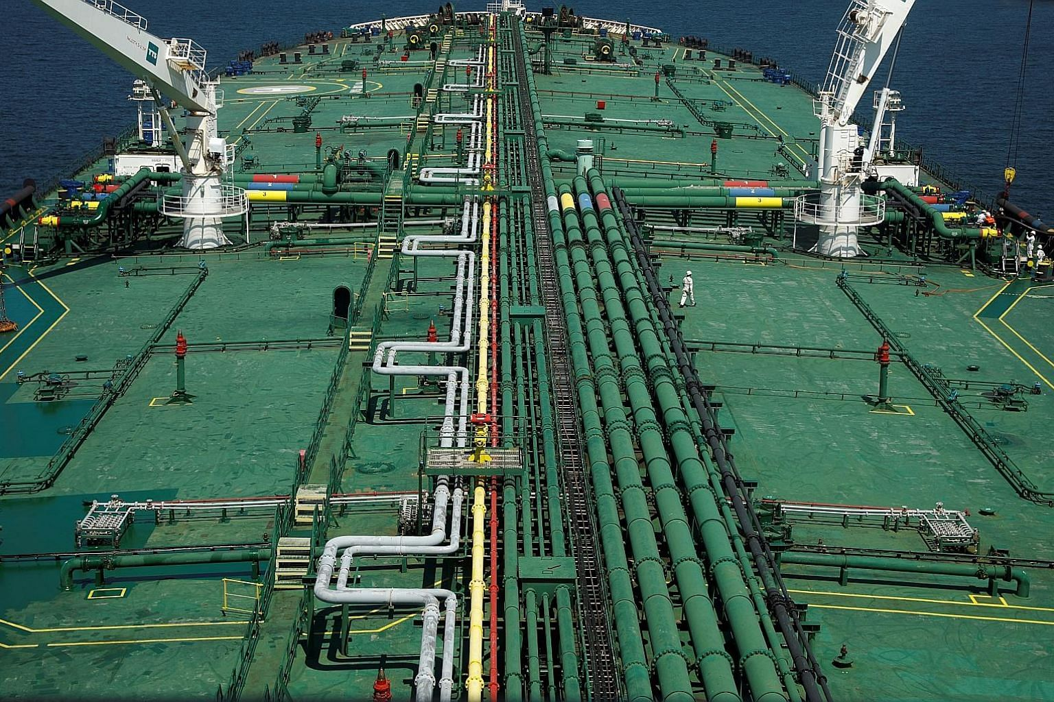 Pipelines running along the deck of Singapore oil trader Hin Leong's Pu Tuo San VLCC (very large crude carrier), when the supertanker was in the waters off Jurong Island last year. The company, founded in 1963, owes some US$3.85 billion (S$5.5 billio