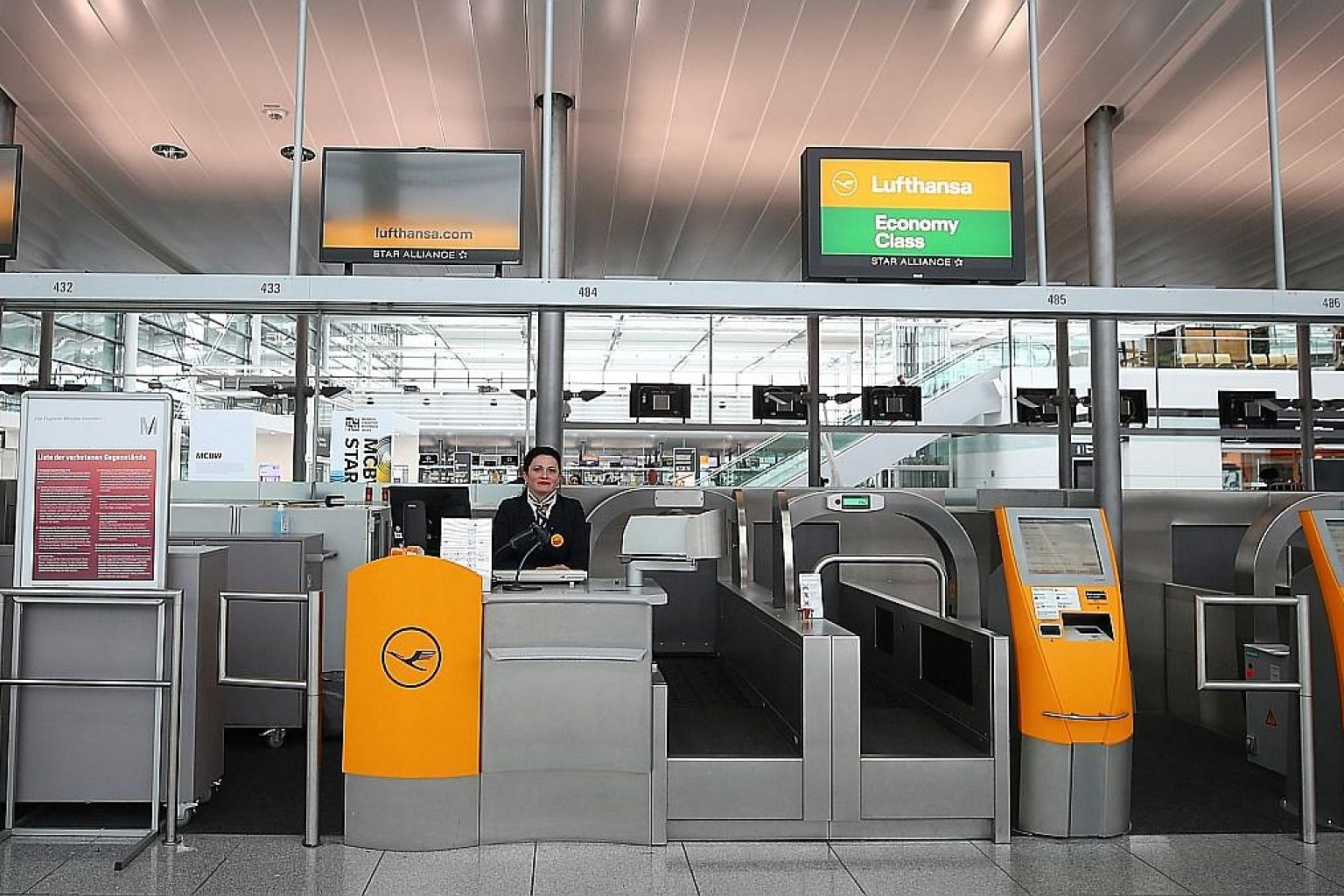 Empty Lufthansa ticket counters at Munich's international airport last month. The carrier has lost 95 per cent of its passengers amid the coronavirus crisis and is looking for help from the German government. Its plight is shared by other carriers in