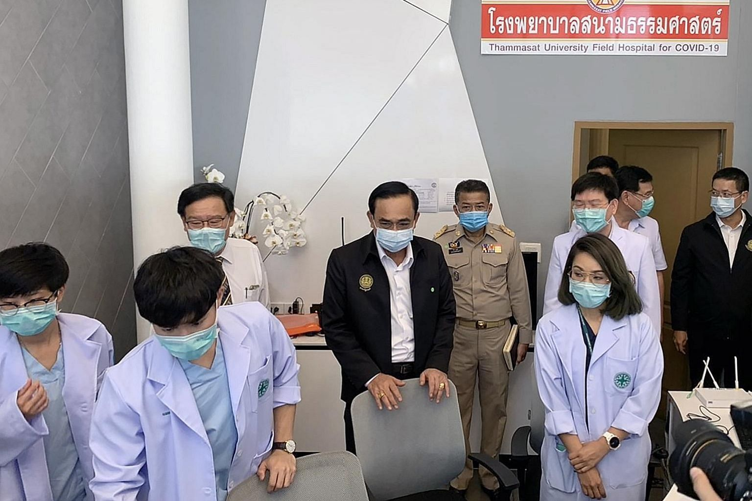 Thai Prime Minister Prayut Chan-o-cha (fourth from left) visiting the Thammasat University Field Hospital on Sunday. While Thailand is gaining control of the coronavirus situation, its economy could shrink 6.7 per cent this year.