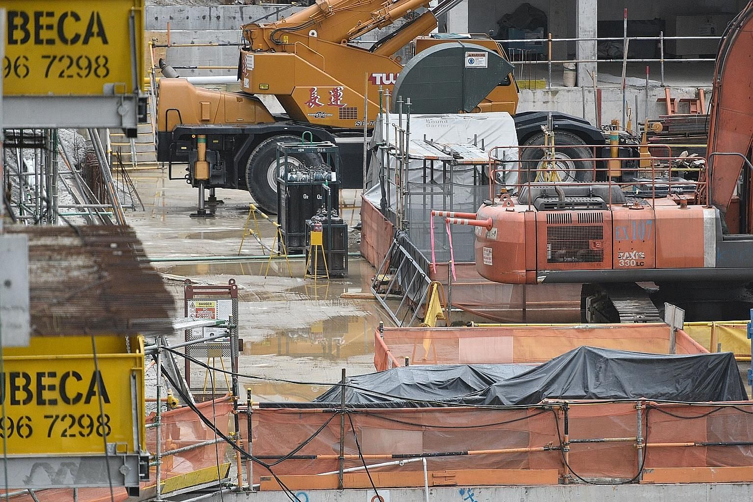 These photographs show construction sites where water can be seen pooling on the ground, in skip bins and on various surfaces.
