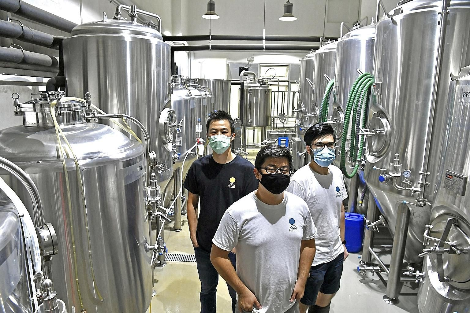 (From left) Off Day Beer Company co-founders Kasster Soh, 33, Kevin Ngan, 39, and Daryl Yeap, 29, at their brewery in Jurong Food Hub. Mr Ngan said that the fund transfer service, which he applied for through OCBC Bank, was particularly useful during