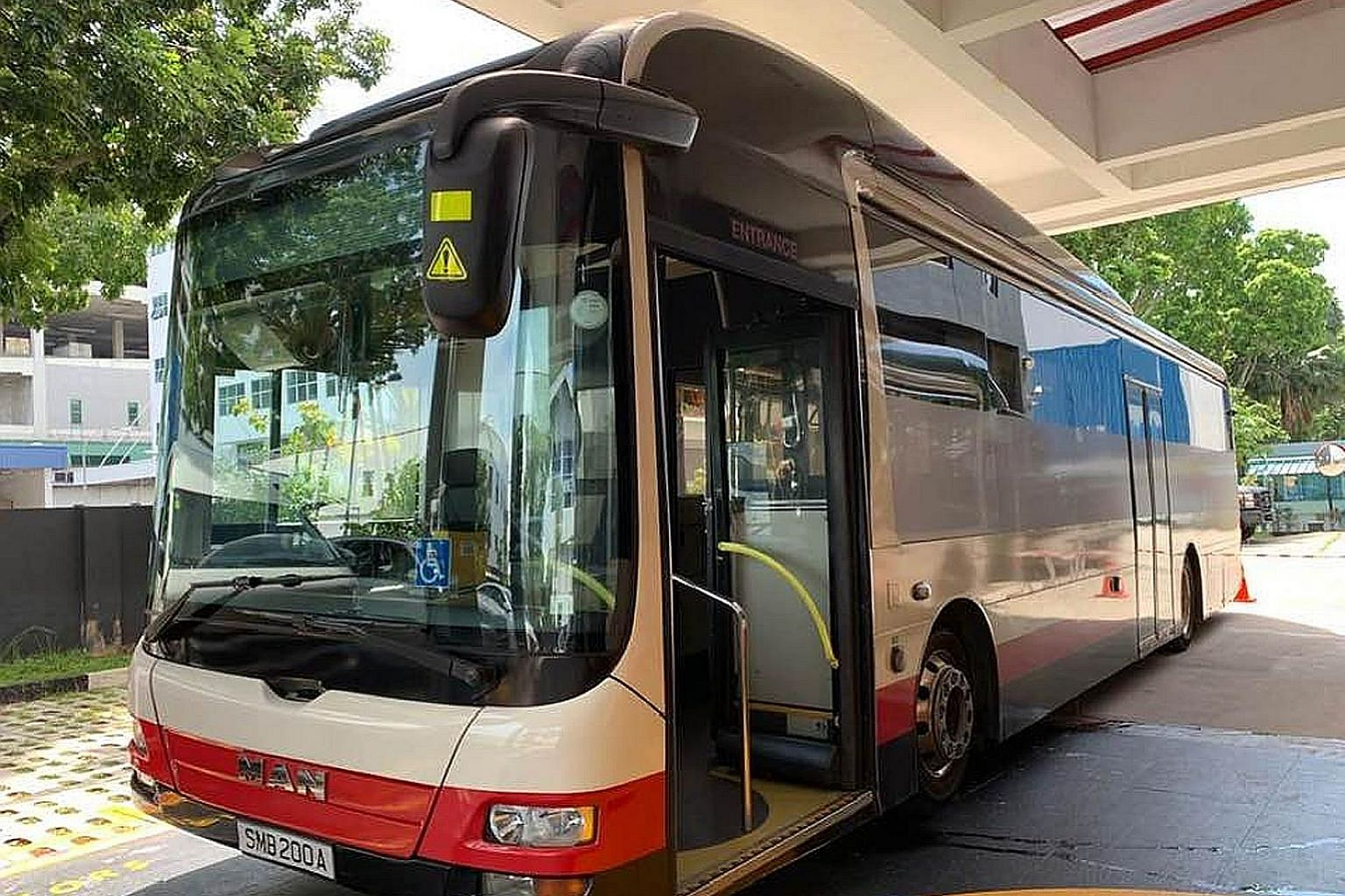 Twenty buses have been retrofitted so that Covid-19 patients can be transported safely between dormitories and hospitals or community care facilities. The driver and passengers are in separate compartments with their own air-conditioning systems, in