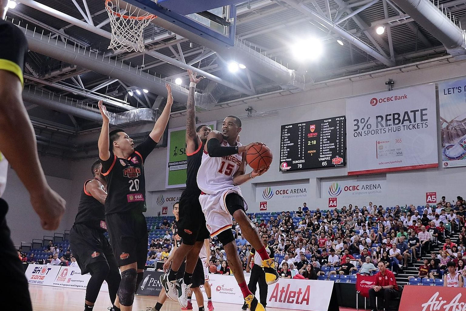 Left: The Singapore Slingers' Xavier Alexander proving a real handful for the Mono Vampire defence at the OCBC Arena on March 24, 2019. He scored 26 points to become the ABL's all-time leading scorer with 2,062 points. Above: The Slingers' Anthony Mc
