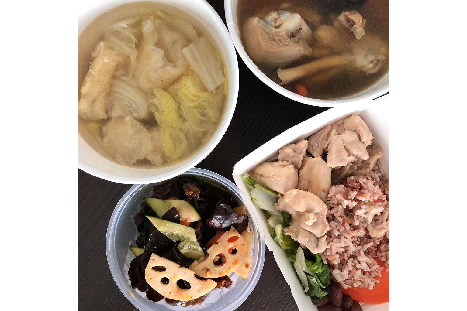 (Clockwise from above left) Chinese Cabbage, Fish Maw And Meatballs Soup; Ginseng Chicken Soup; Rice Wine Chicken With Healthy Mixed Rice, Vegetable, Peanuts; and Oriental Salad - Black Fungus & Lotus Roots from The Herbal Bar.