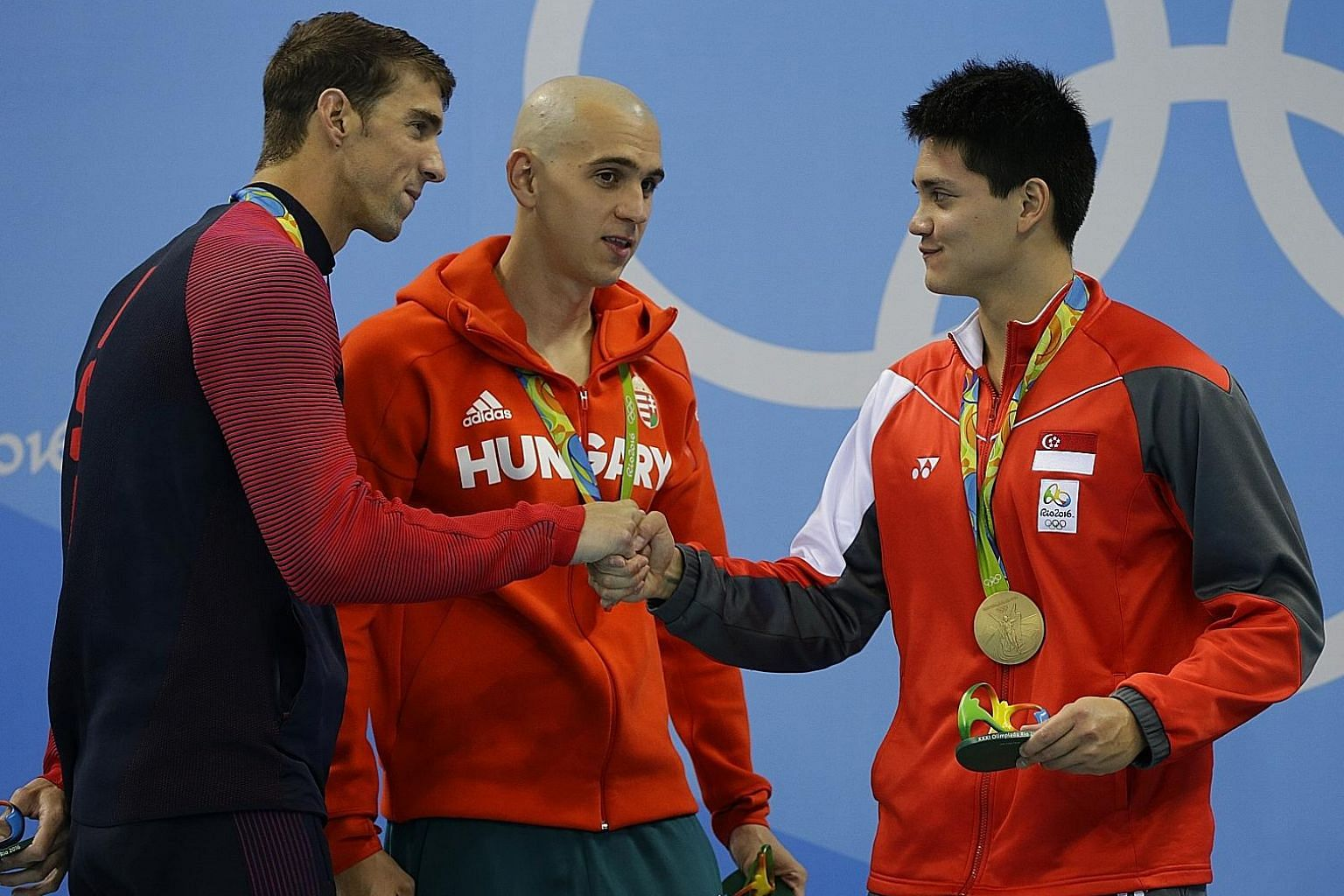Joseph Schooling, then only 13 in 2008, posing with Michael Phelps. Eight years later, he beat his idol in Rio to win Singapore's first Olympic gold medal.